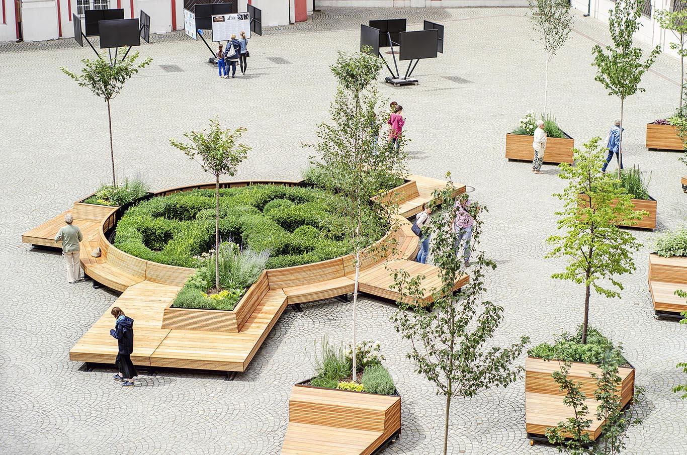 Mobile benches wrap around a circular garden.