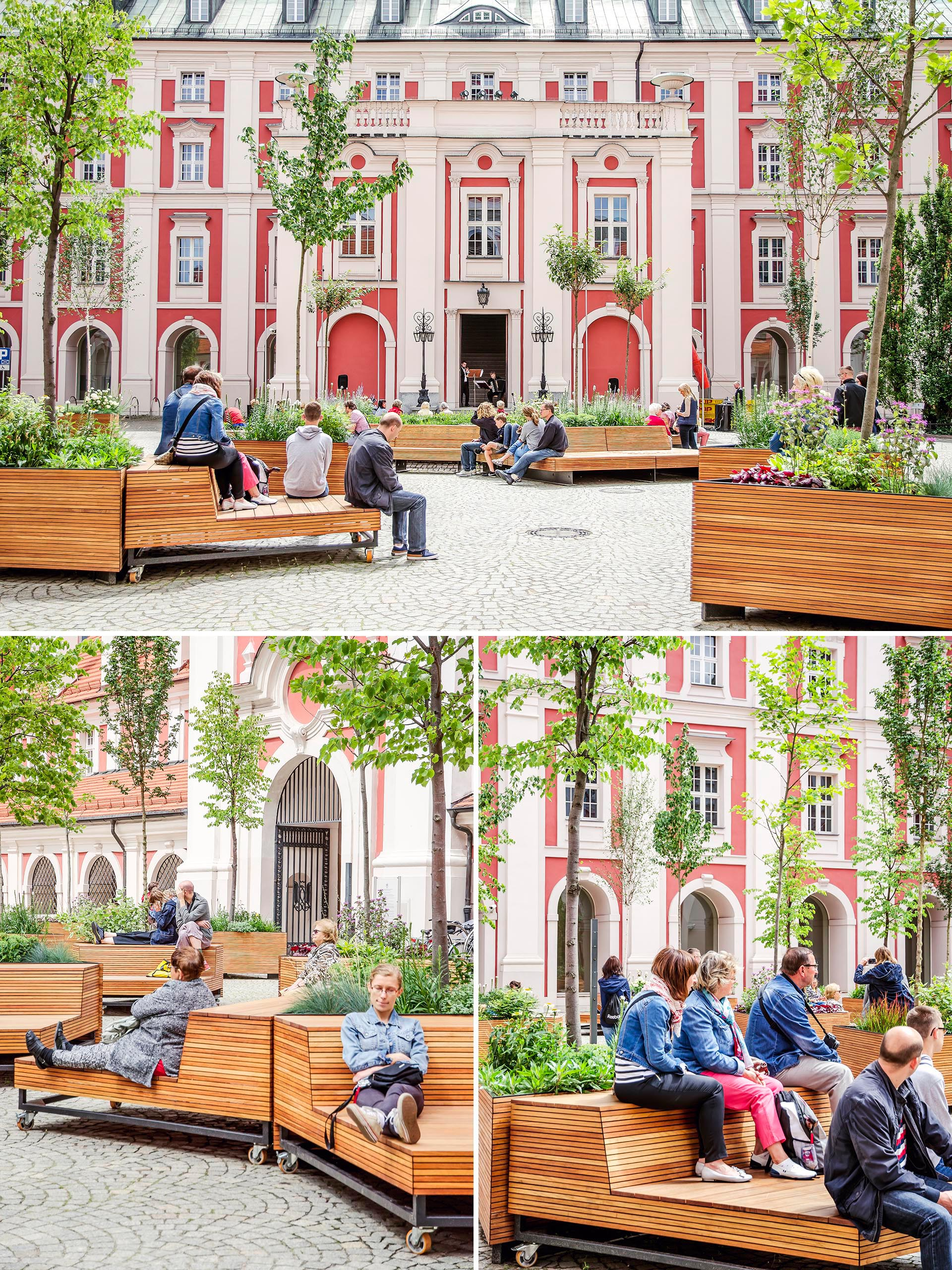 Mobile wood benches rest against triangular planters in a courtyard.
