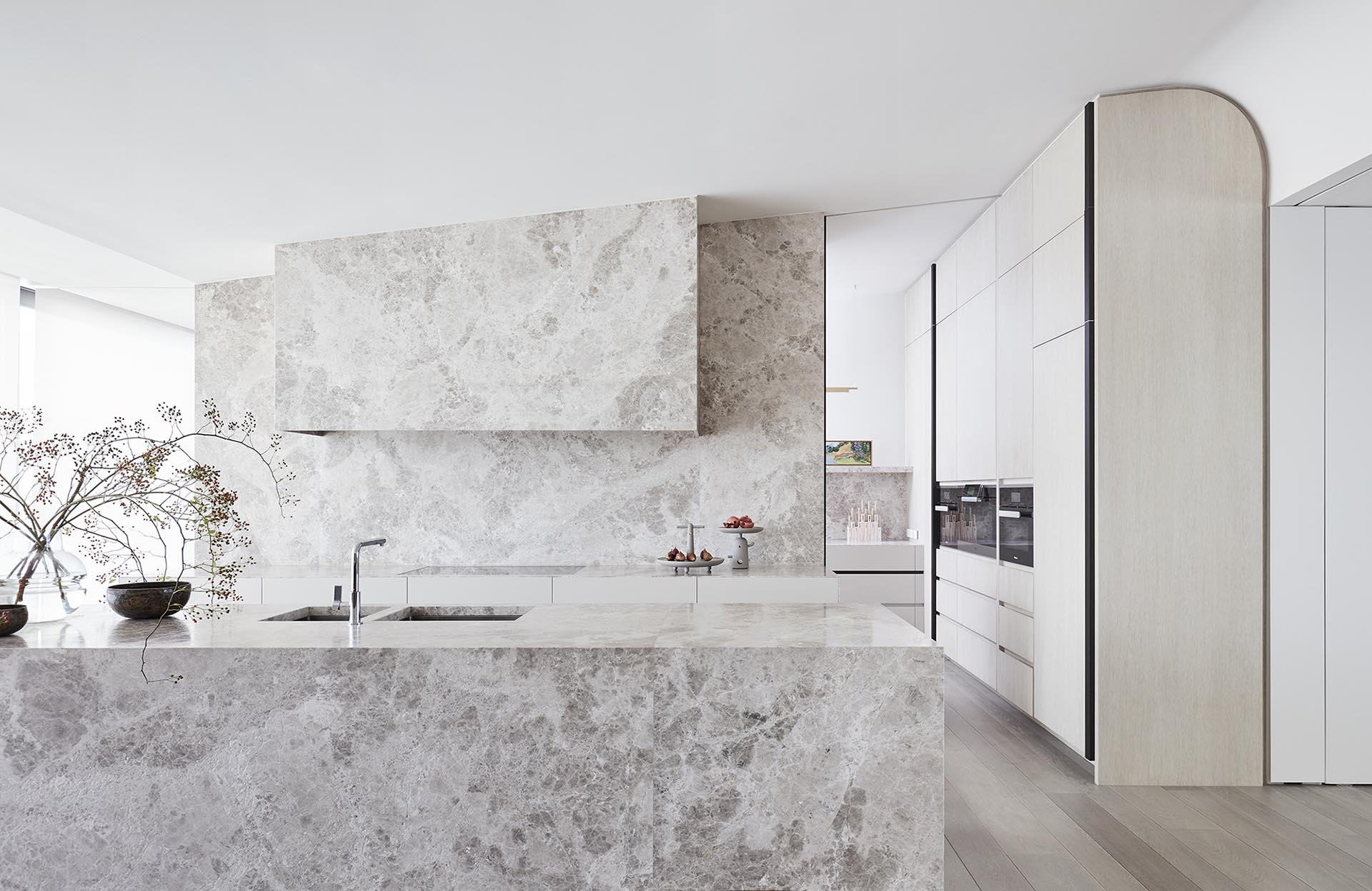 Limestone Was Used Throughout This Modern Kitchen To Create A Cohesive Look