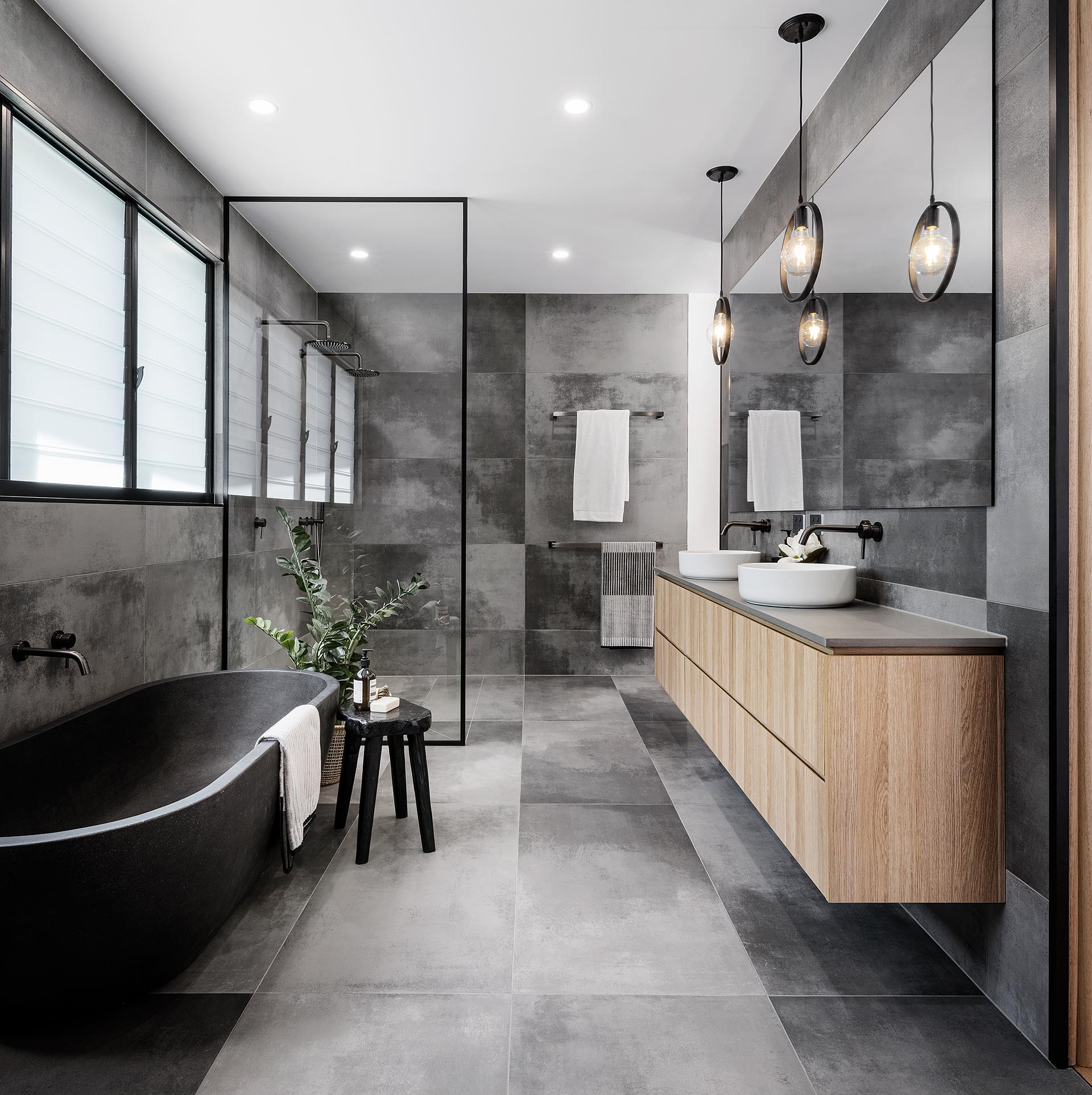 A Cloudy Grey Tile Sets The Palette For This Bathroom