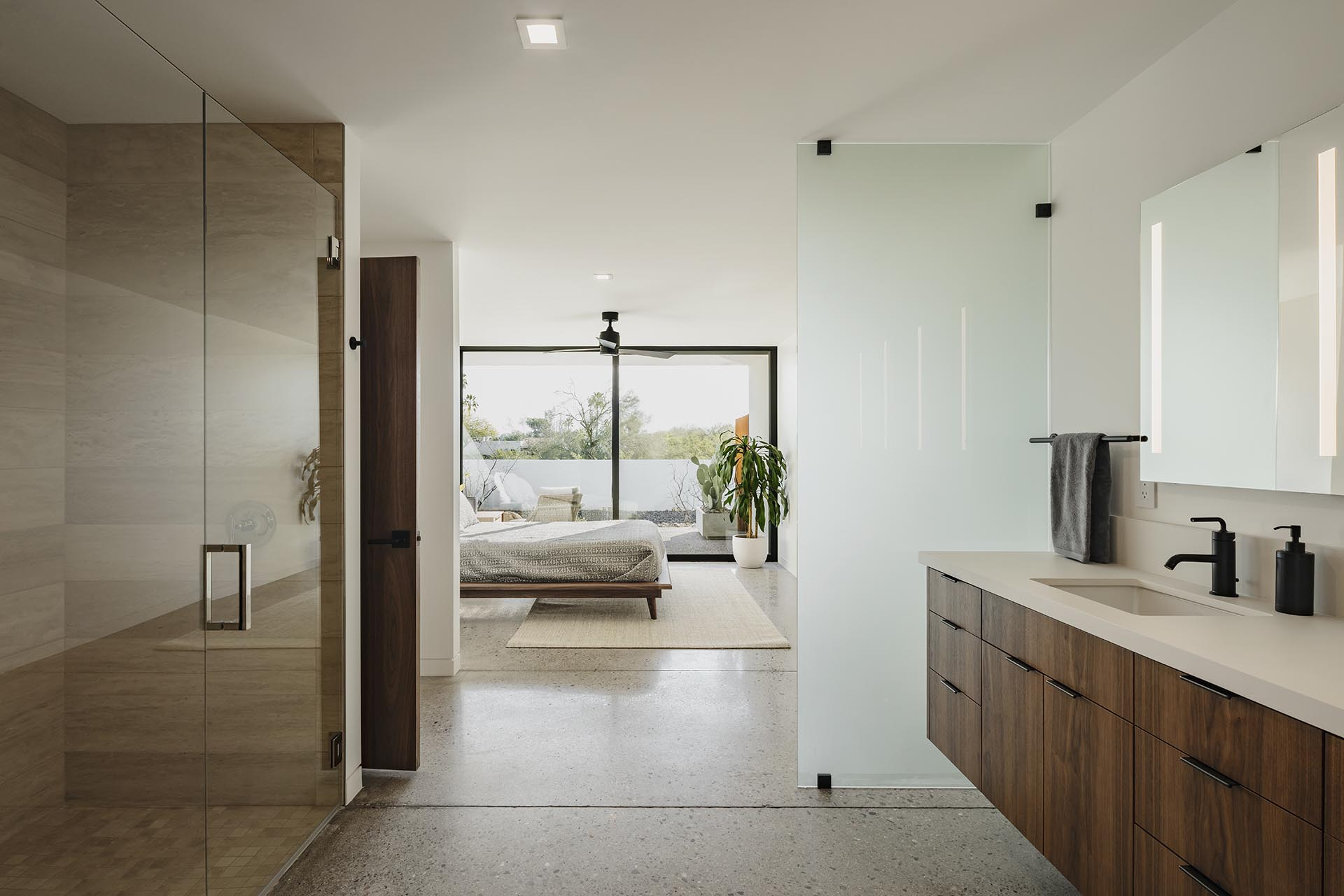 A modern bedroom that opens to the bathroom.