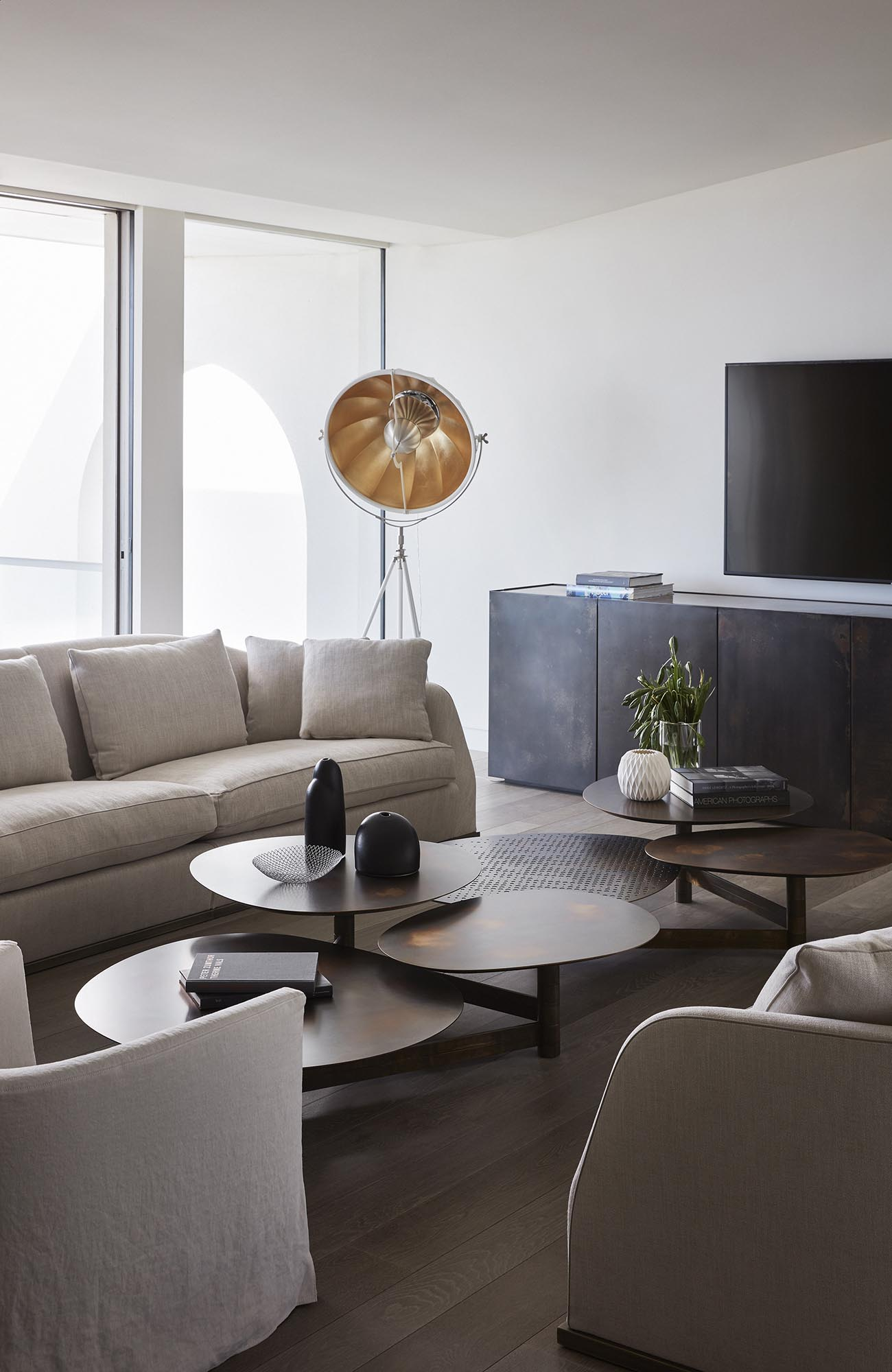 Modern living room with multi-height tables.