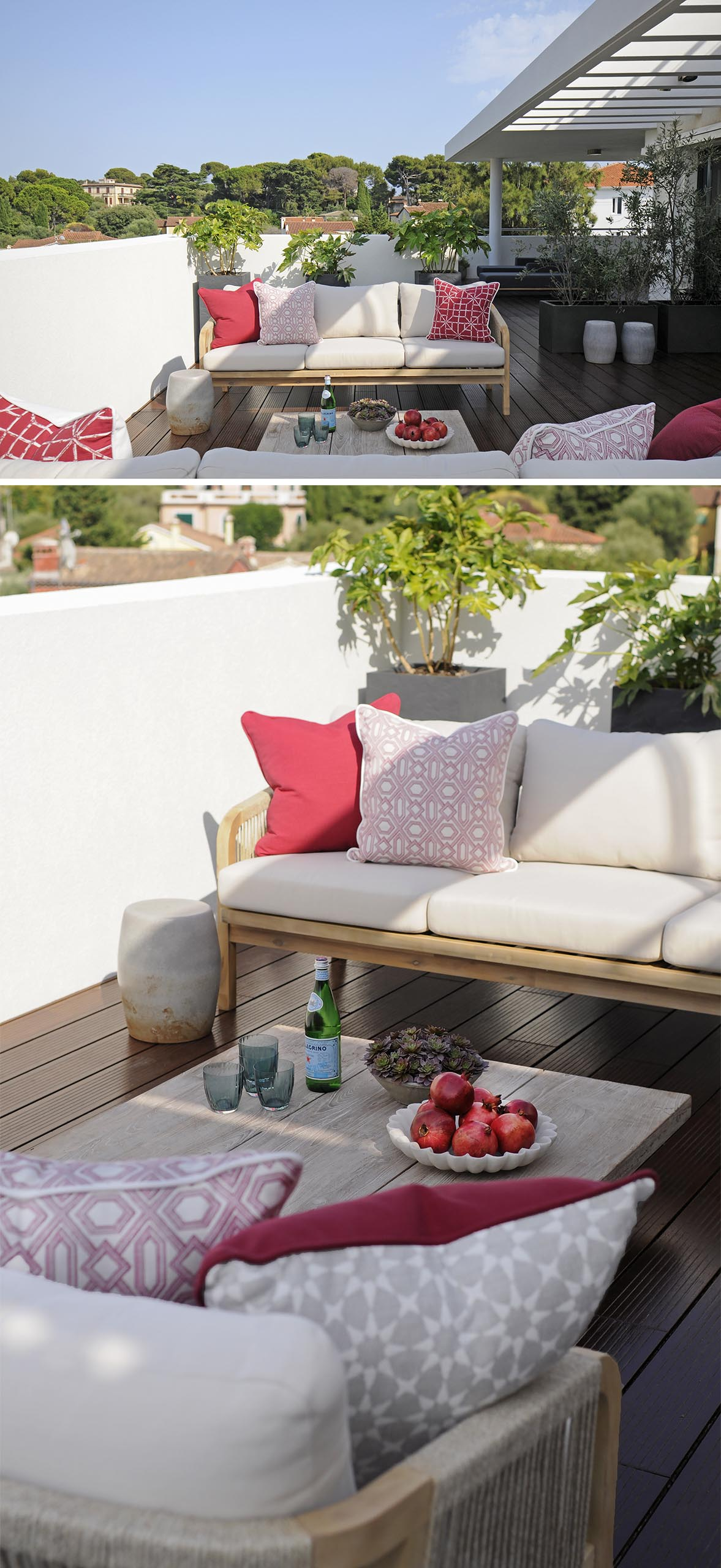 An outdoor terrace with sofas and red cushion accents.