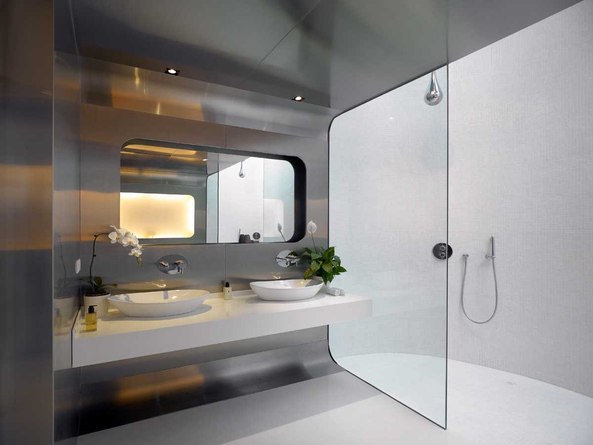 A modern, easy to clean bathroom with stainless steel walls.