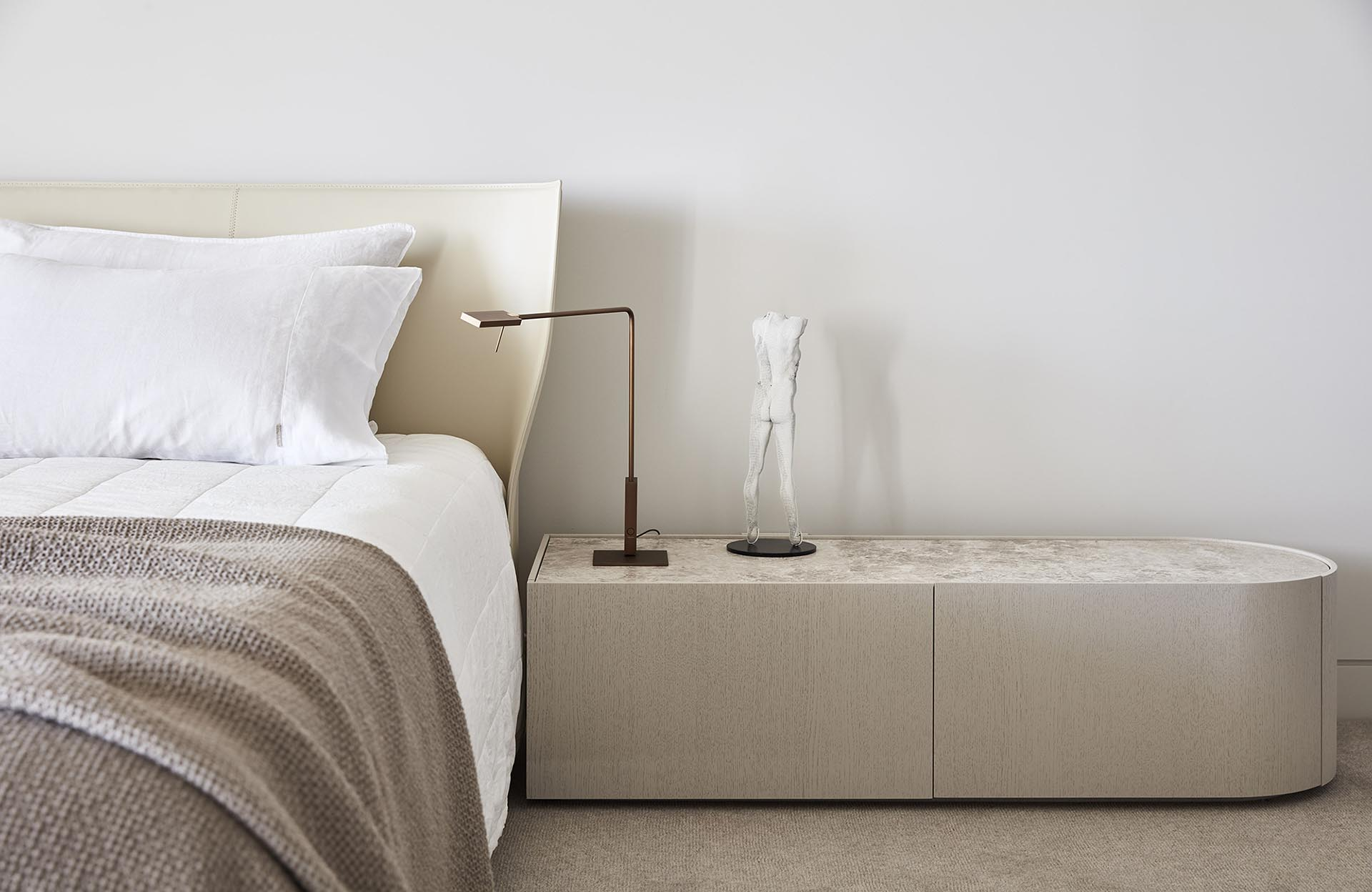 A modern bedroom with a neutral color palette.