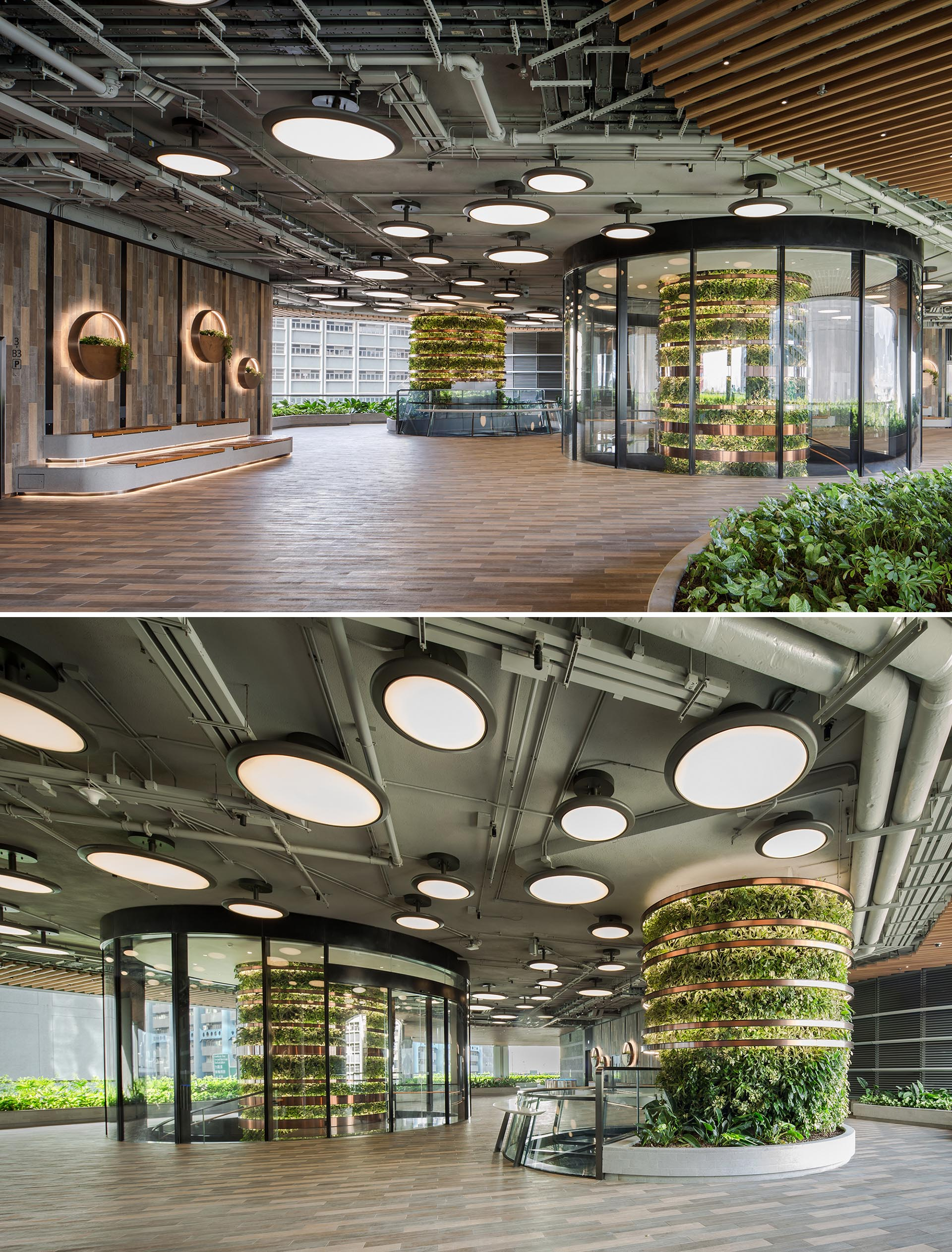 Vertical gardens in the shape of columns traverse multiple floors of an office building.