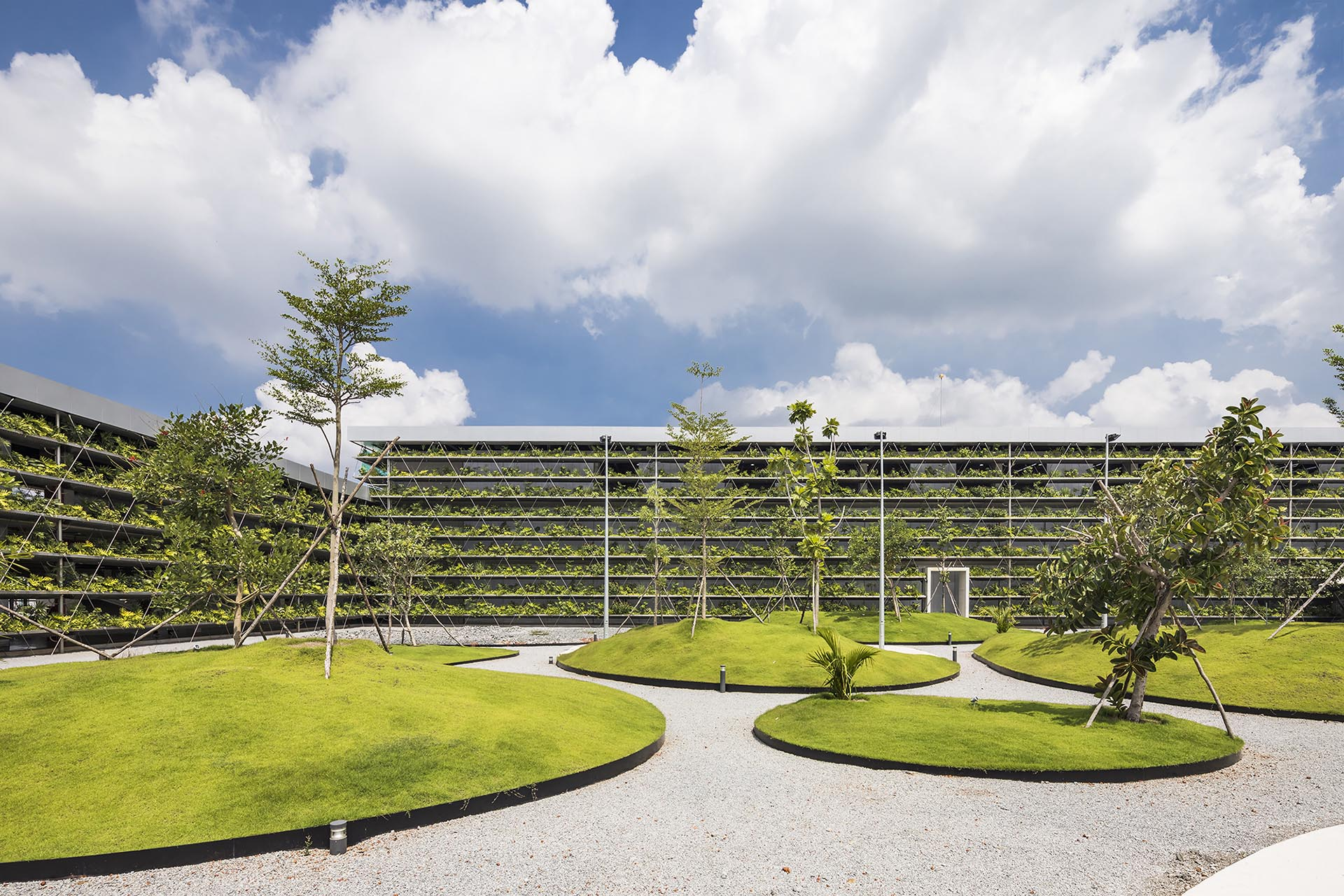 A central courtyard with grassy patches and trees.