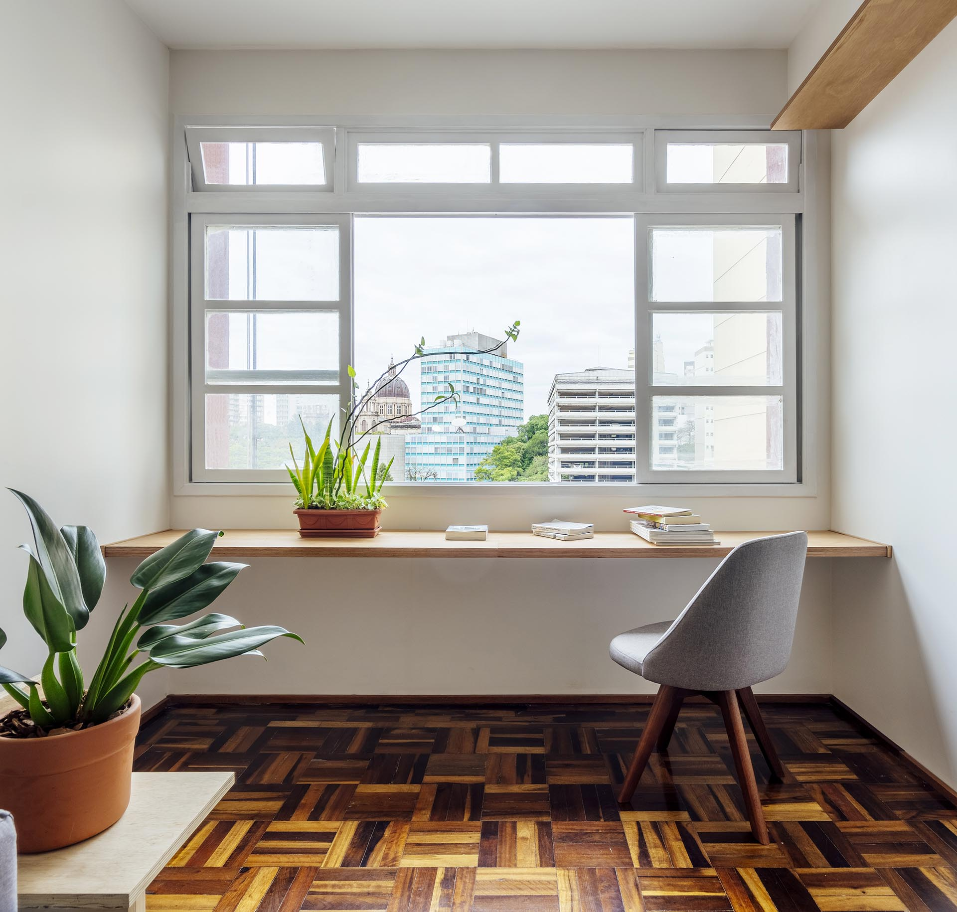A simple home office was created using a wood desk top.