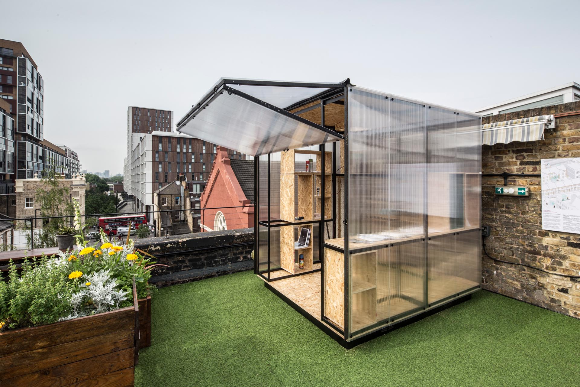 Translucent Walls Allow Light Into This Small Building Designed To Be Used As A Home Office Or Workshop