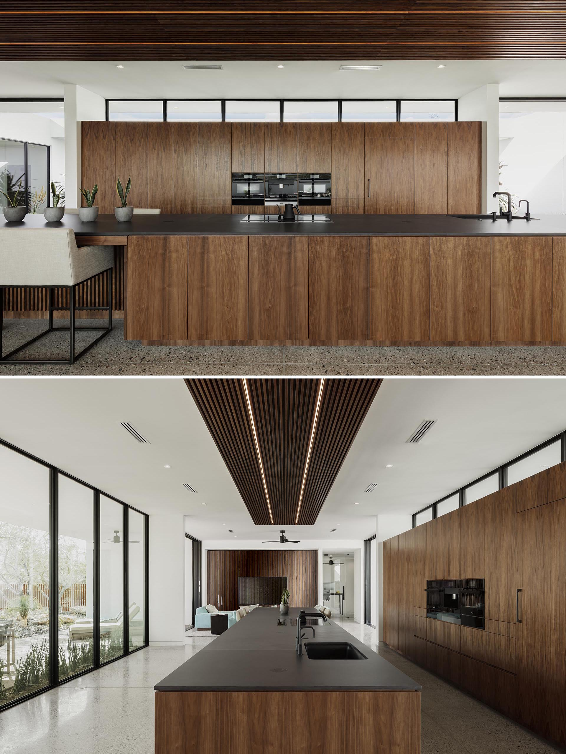 A modern wood and black kitchen.