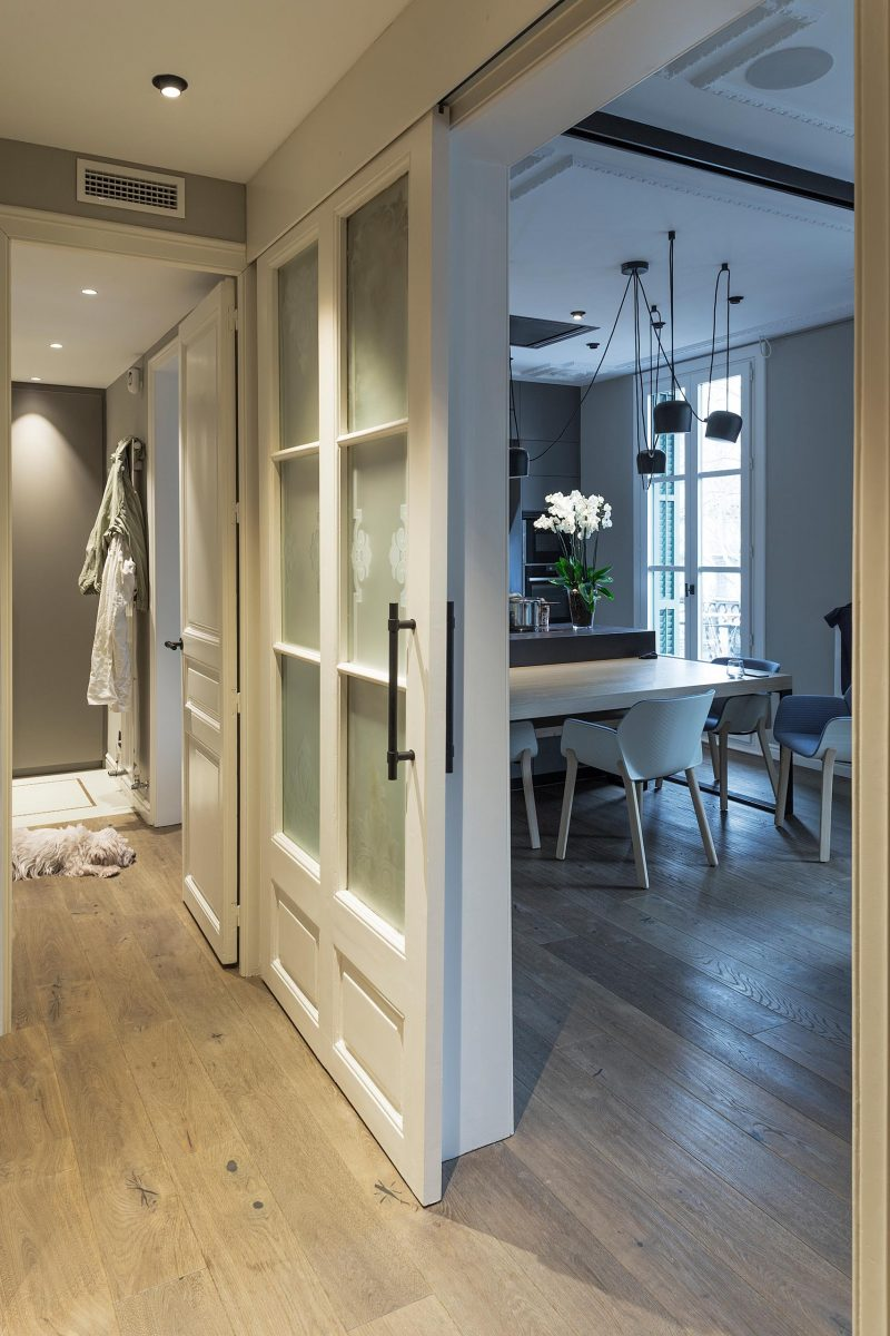 A remodeled apartment uses a sliding door to save space.