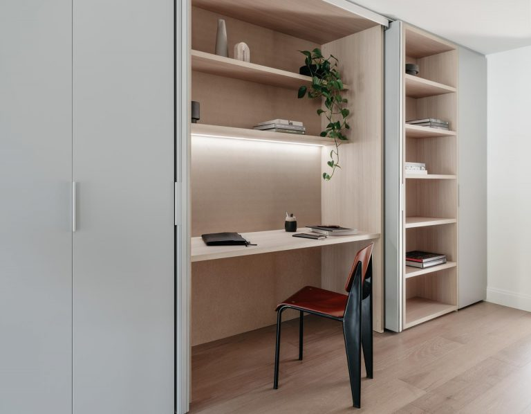 A Home Office In A Wall Of Cabinets Is A Good Idea For Apartment Living