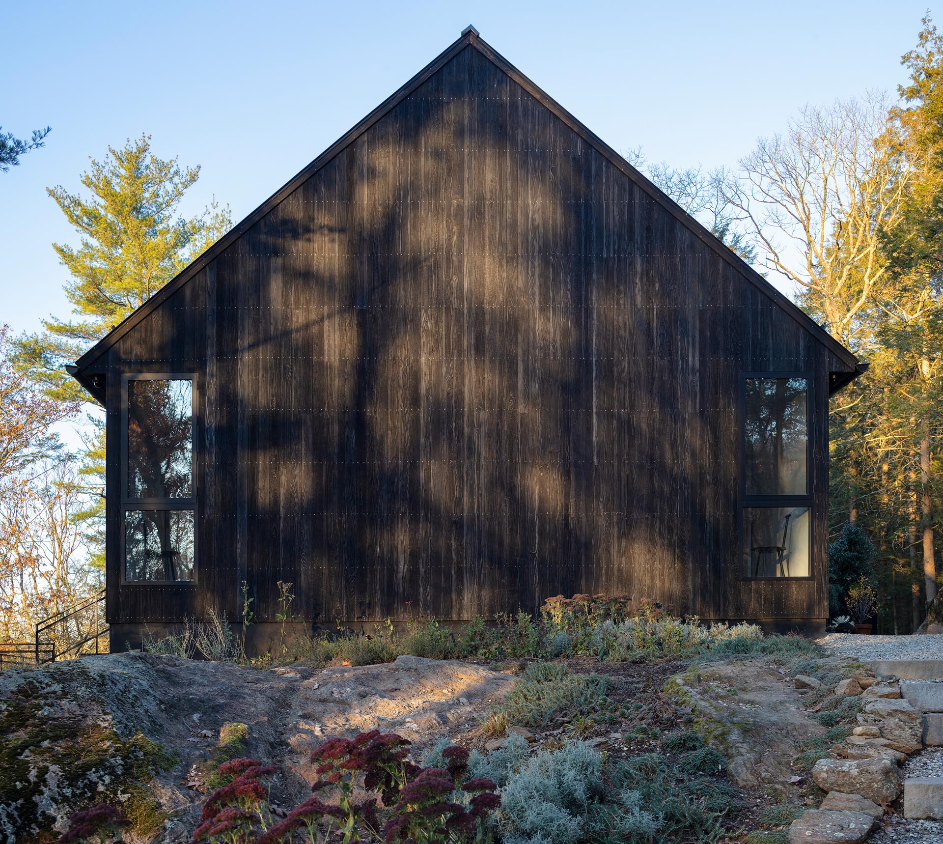 A modern black house with Shou Sugi Ban exterior siding.