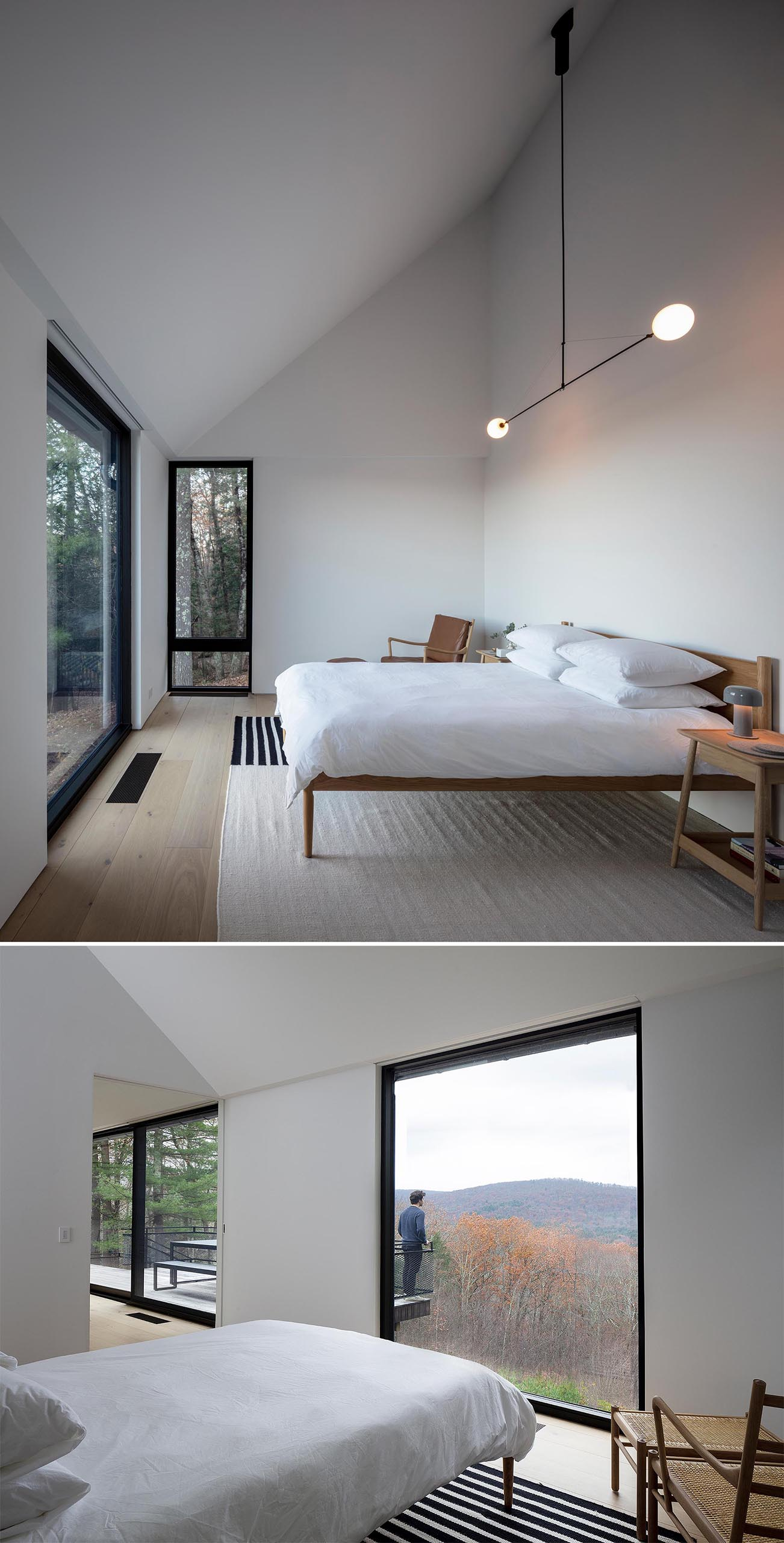 A minimalist master bedroom with a sloped ceiling, white walls, a large rug, and modern wood furniture.