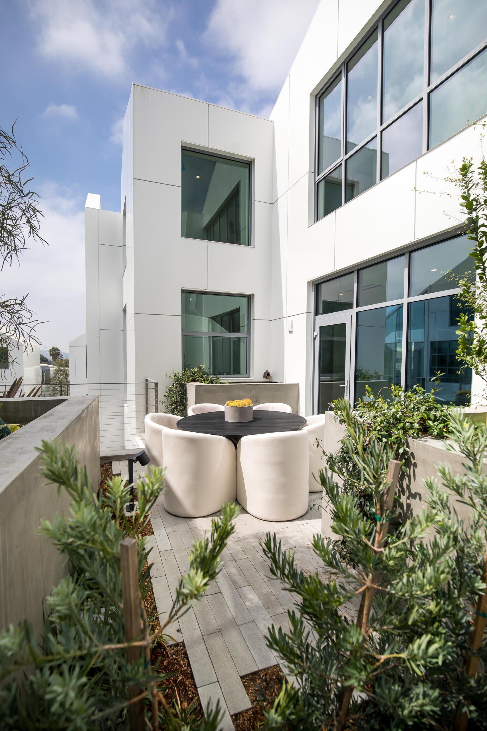 A modern terrace with a dining table.
