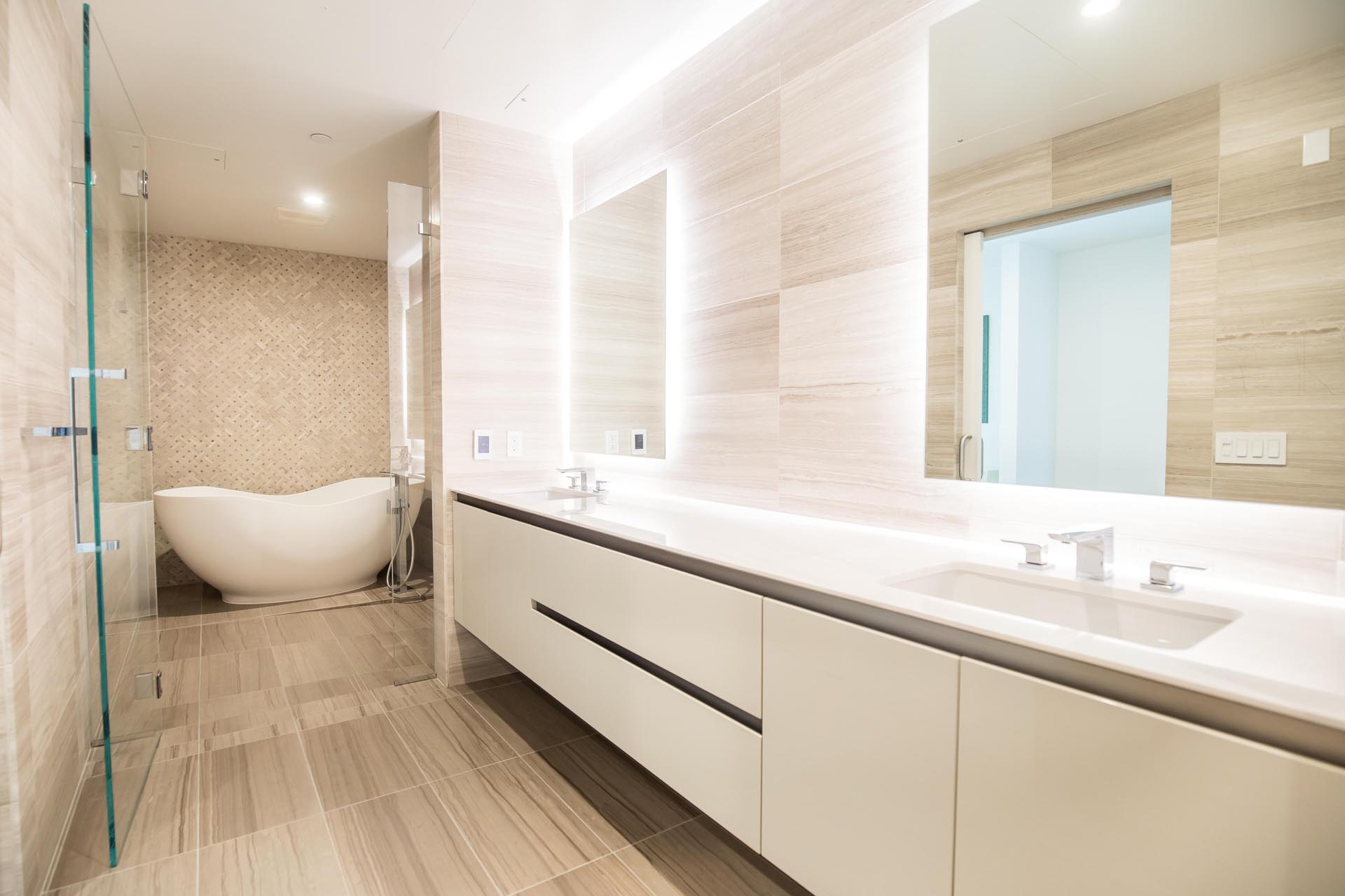 A modern bathroom with neutral color palette.