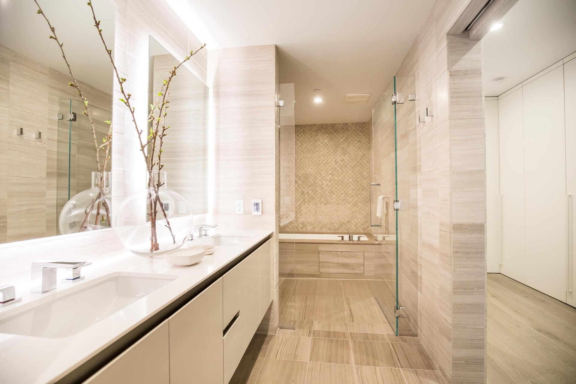 A modern bathroom with a neutral color palette.