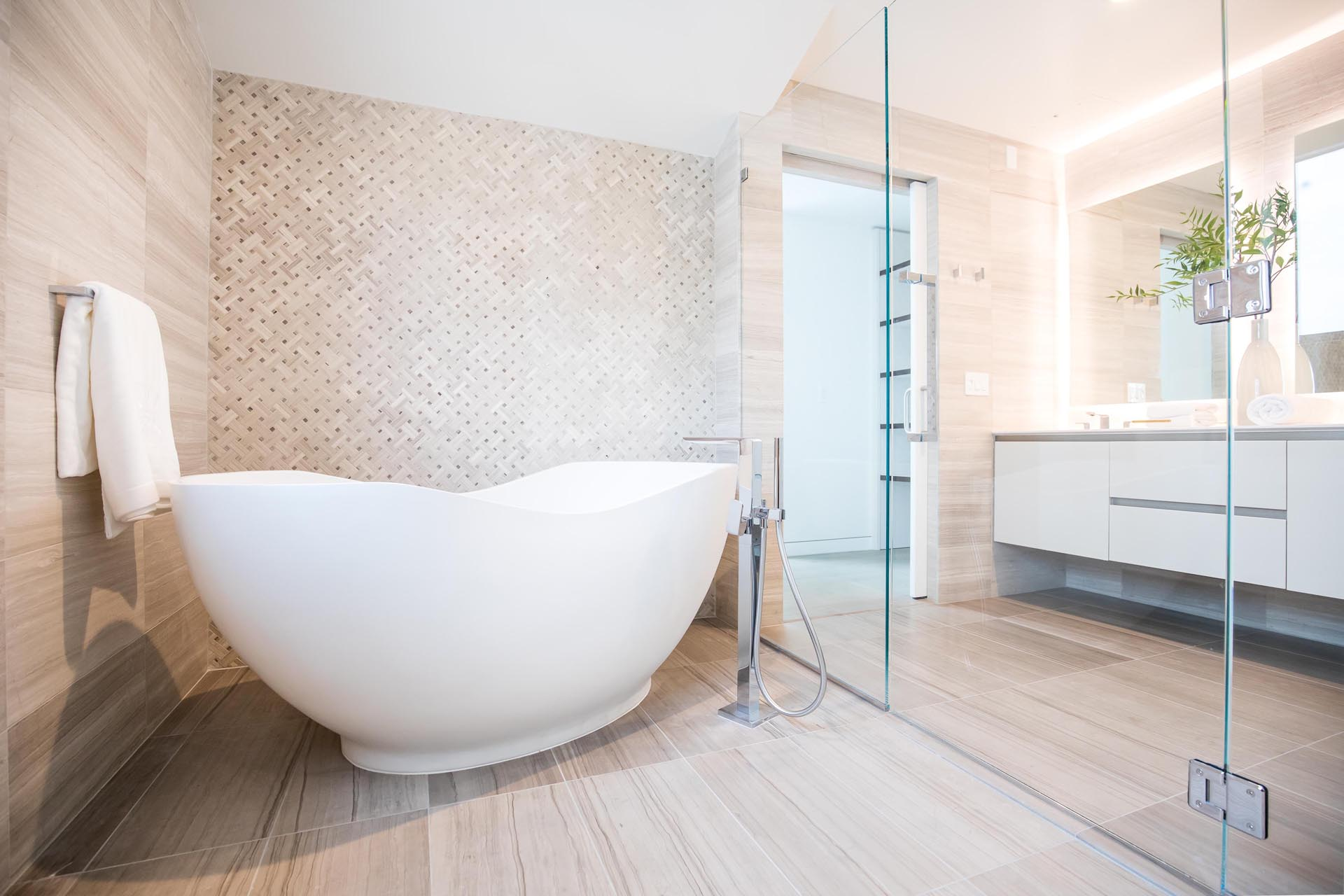 A modern bathroom with a neutral color palette and freestanding bathtub.