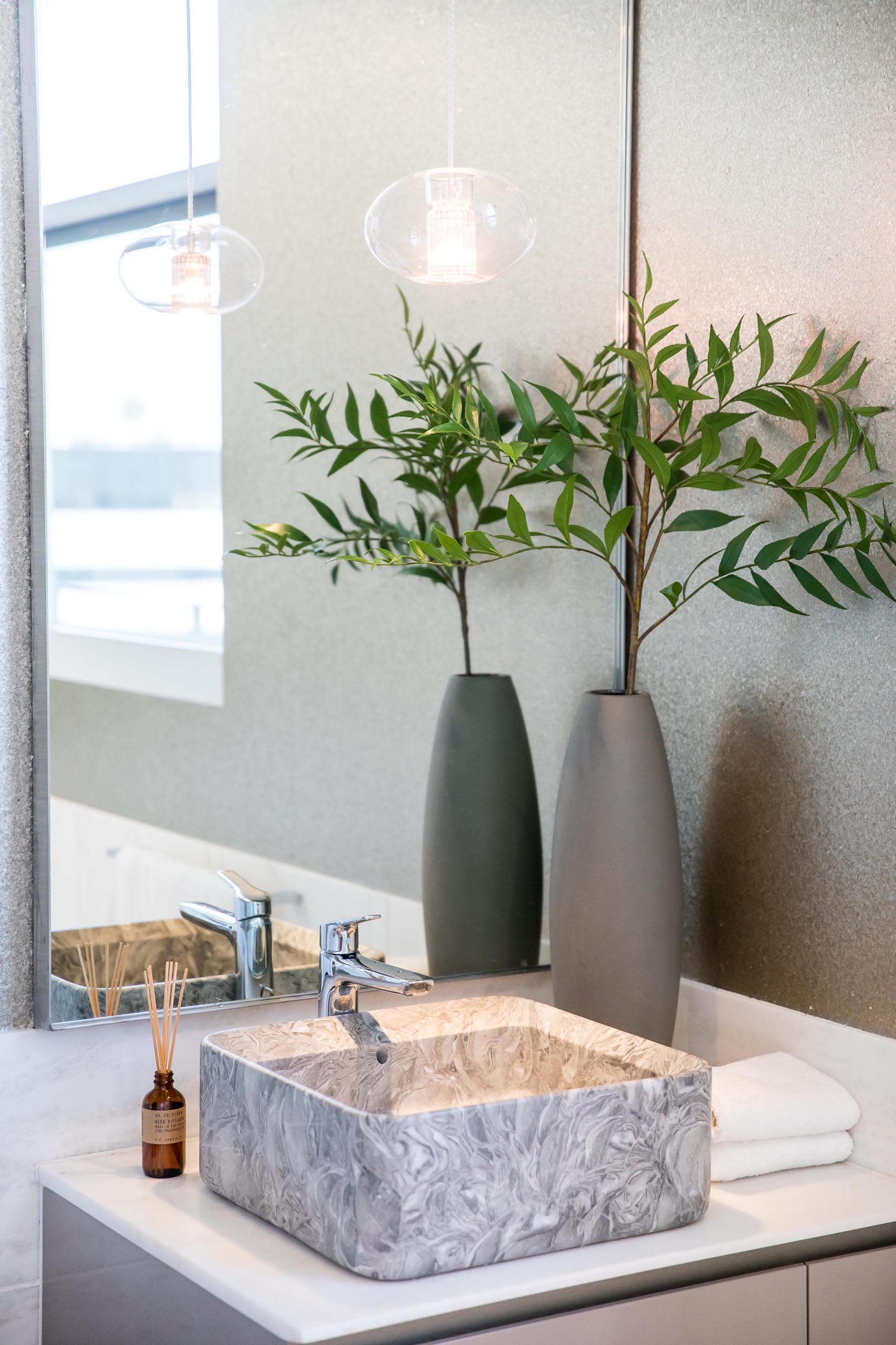 A modern bathroom with a square vessel sink.