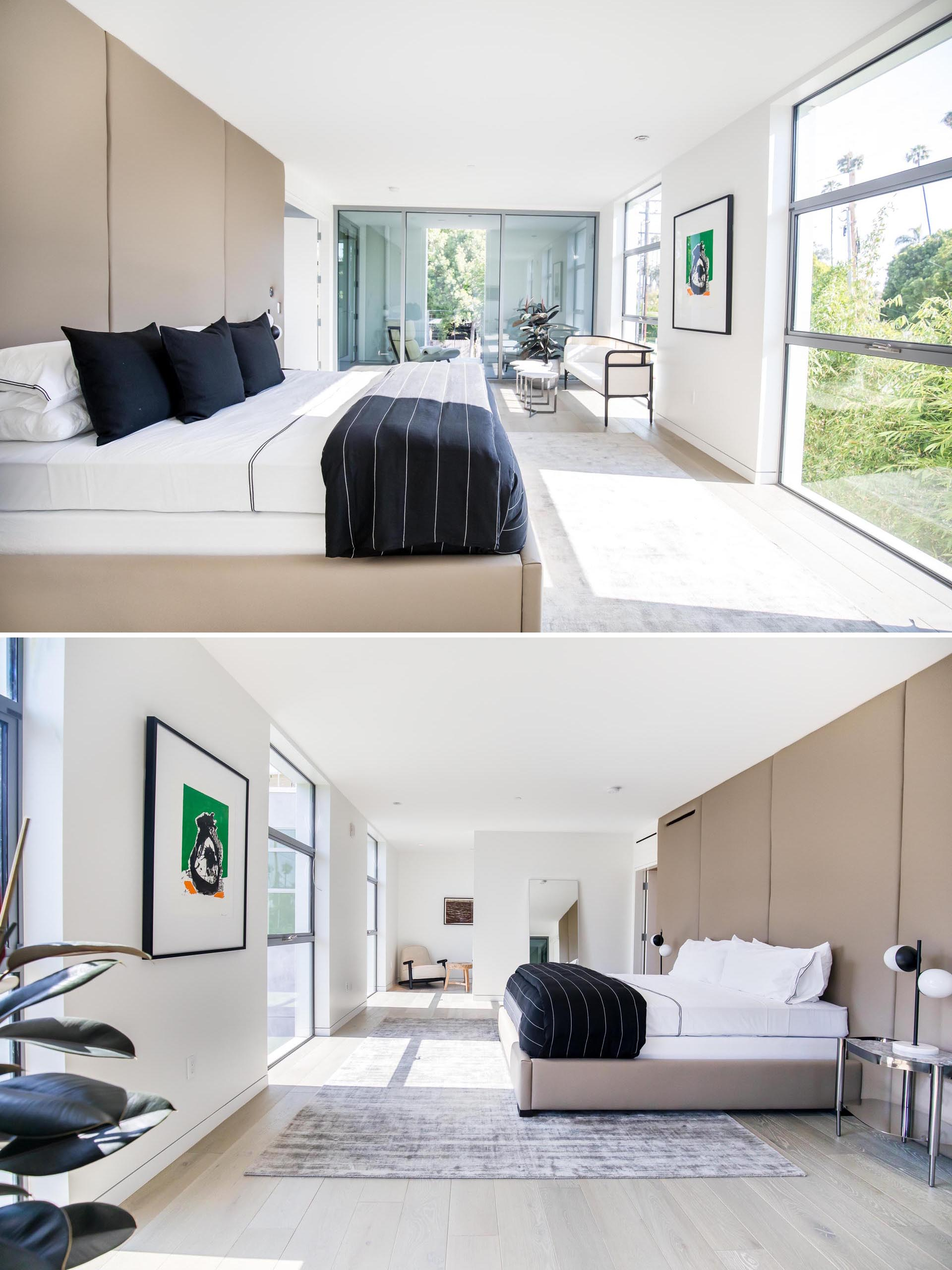 A modern master bedroom with minimal furnishings.