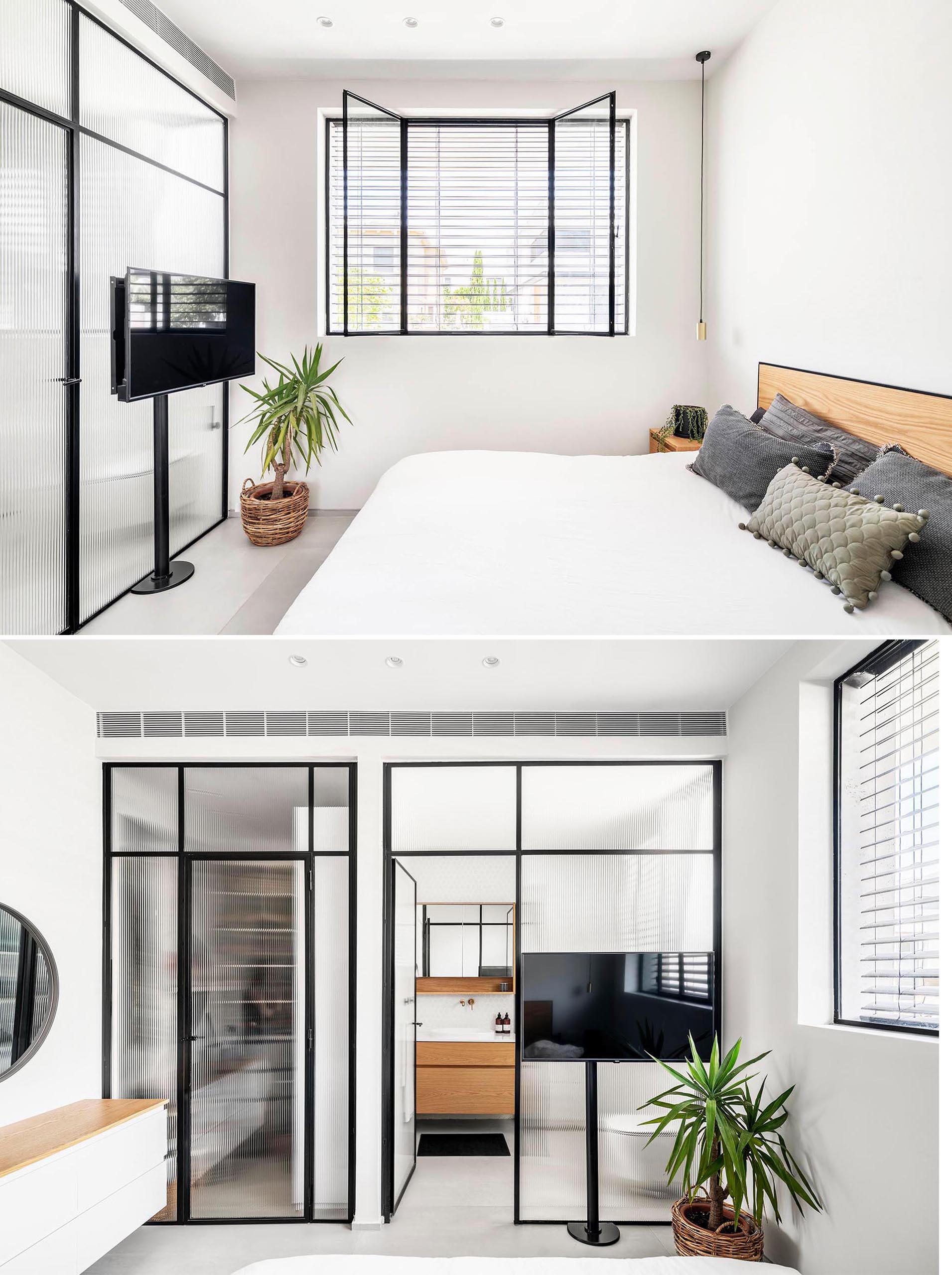This modern master bedroom has an en-suite bathroom and built-in closet. Stripe-textured glass with iron frames separates these areas without obscuring the light.