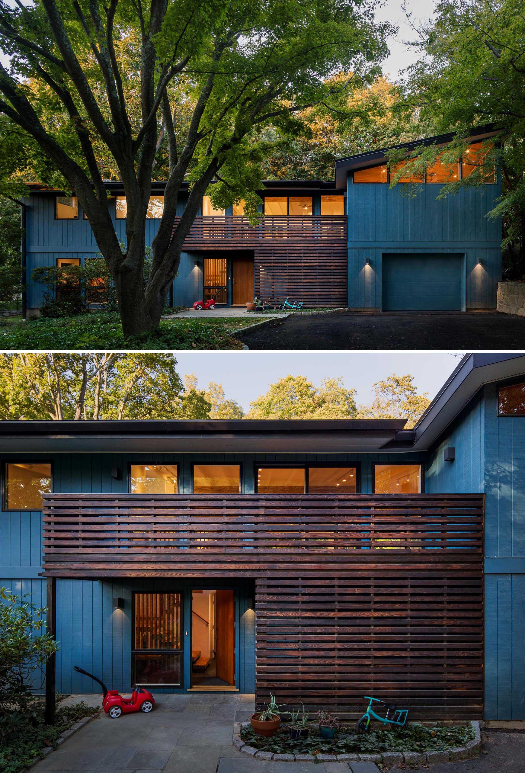 A home with a deep blue exterior and dark wood accent.
