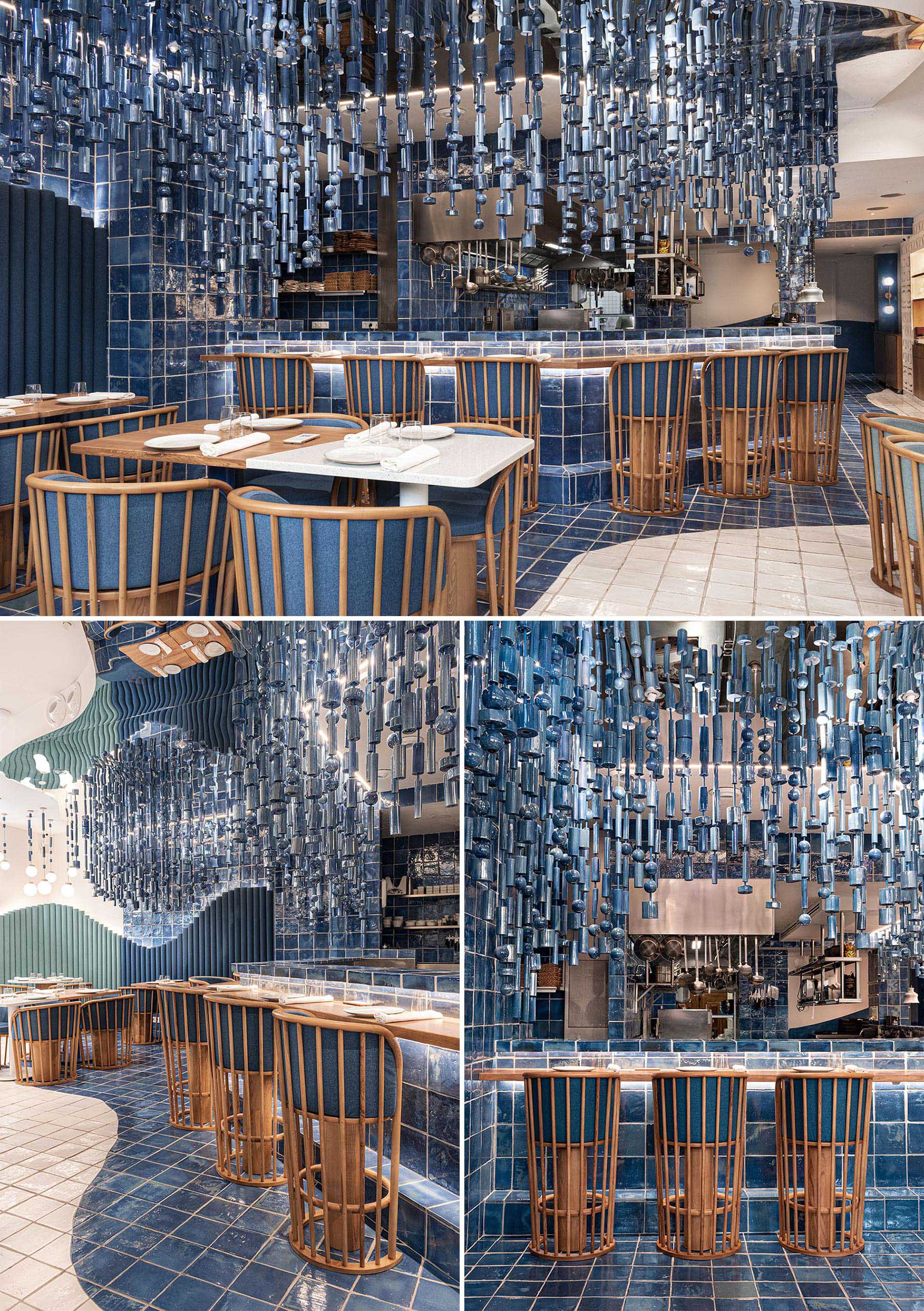 A modern restaurant with hanging blue ceramic pieces was inspired by the sea.