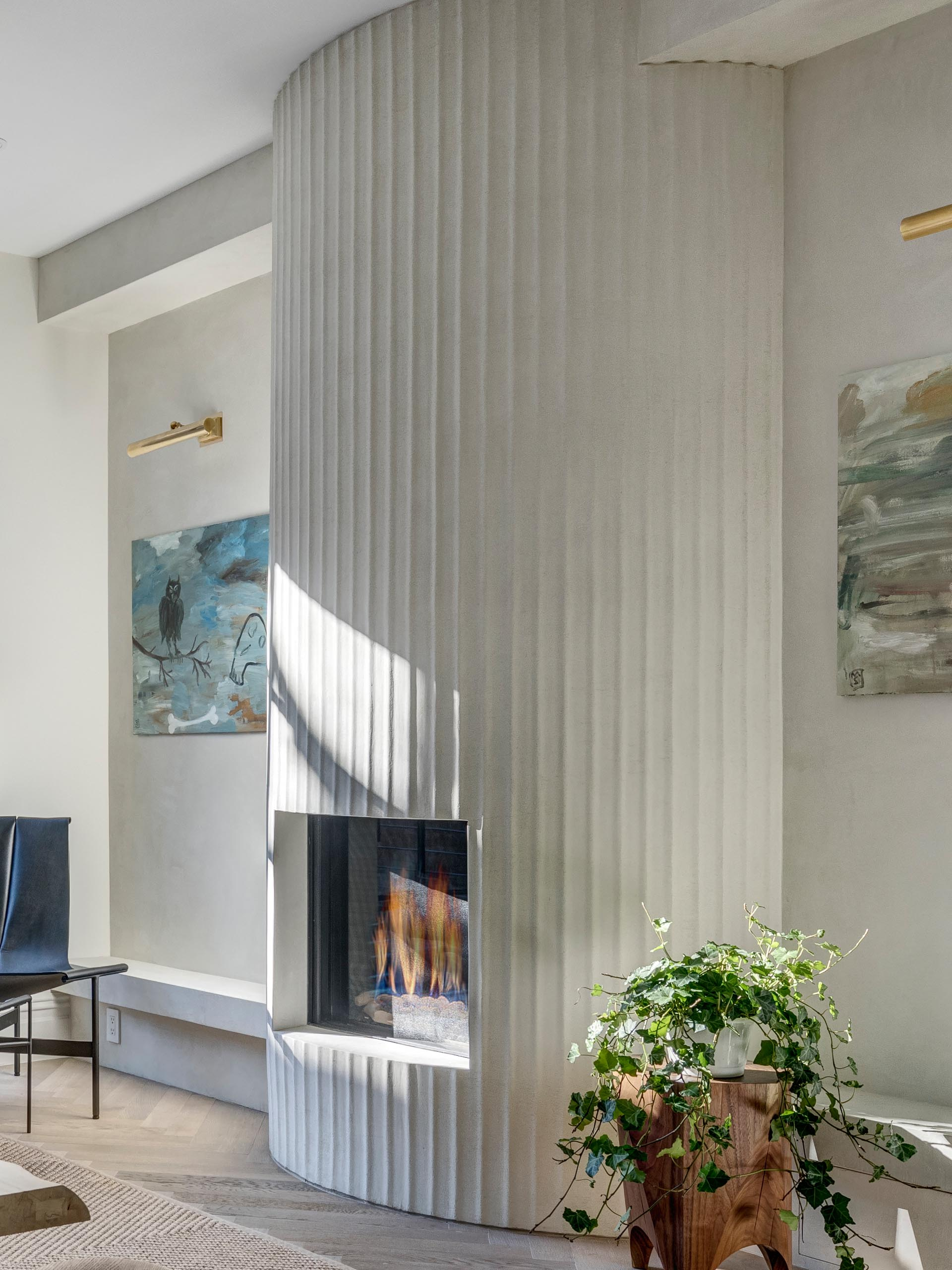 A modern fluted fireplace surround with a white finish.