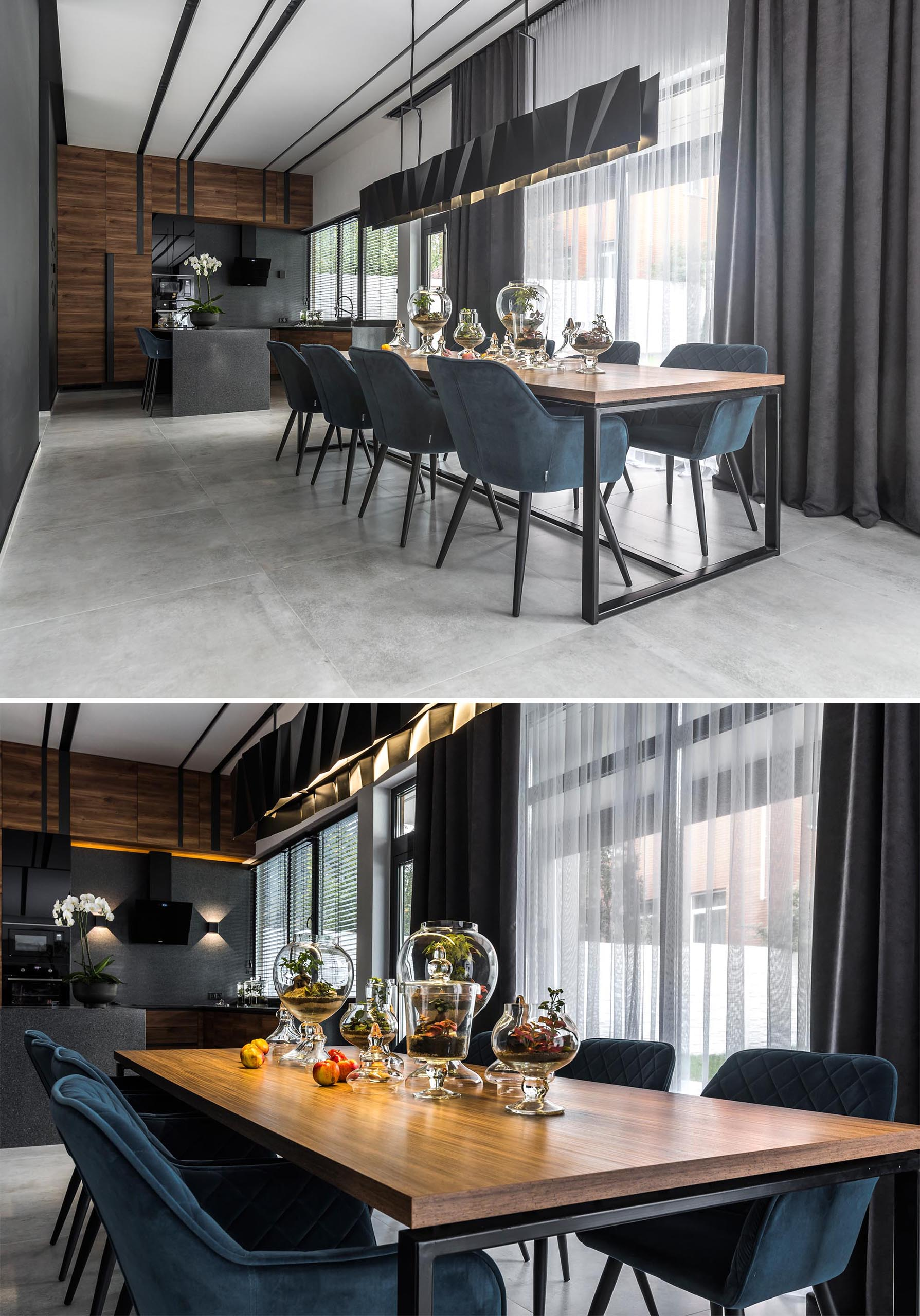 A modern dining room with a long matte black metal lighting fixture.