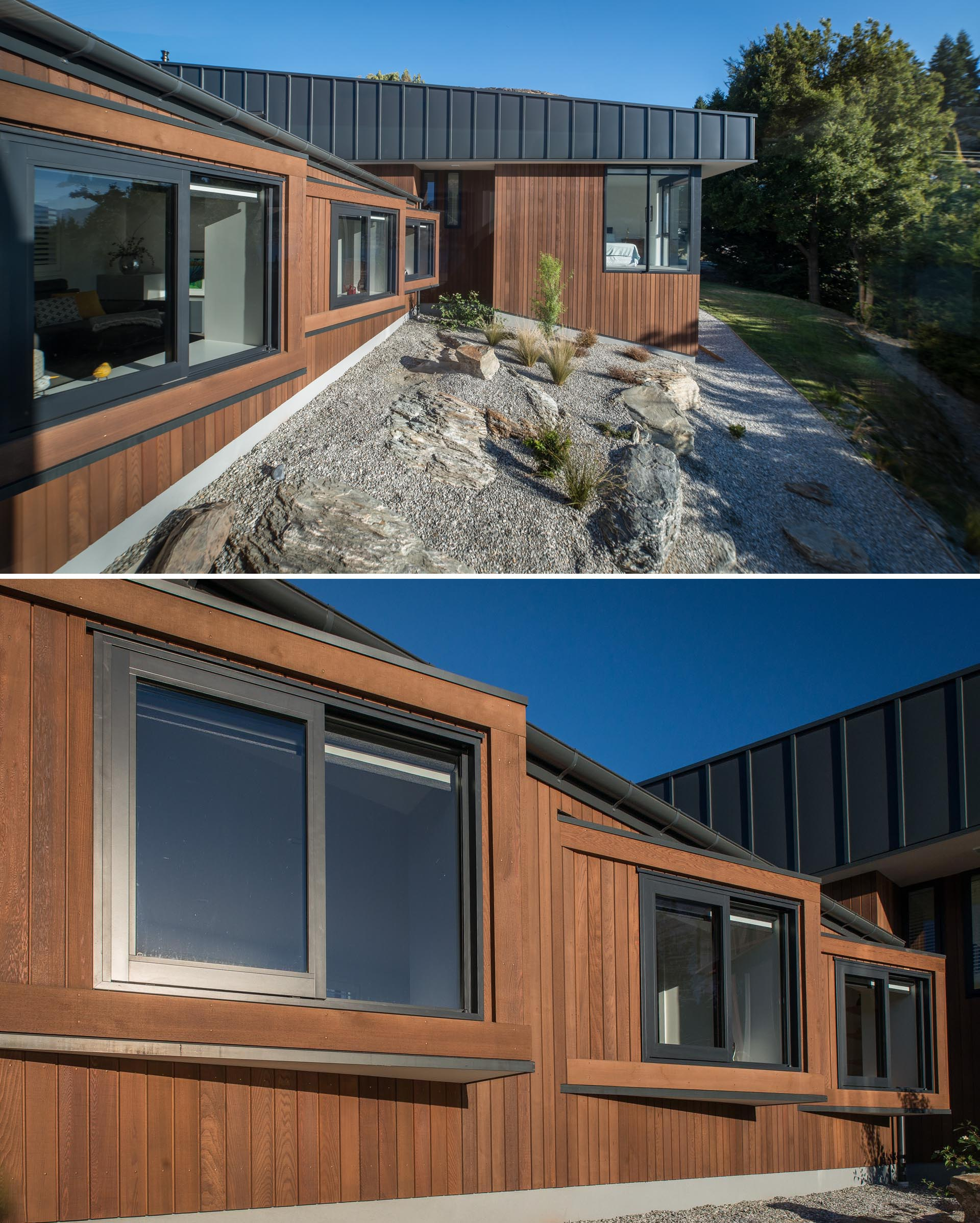 A modern house with wood and matte black metal siding, and angled windows.