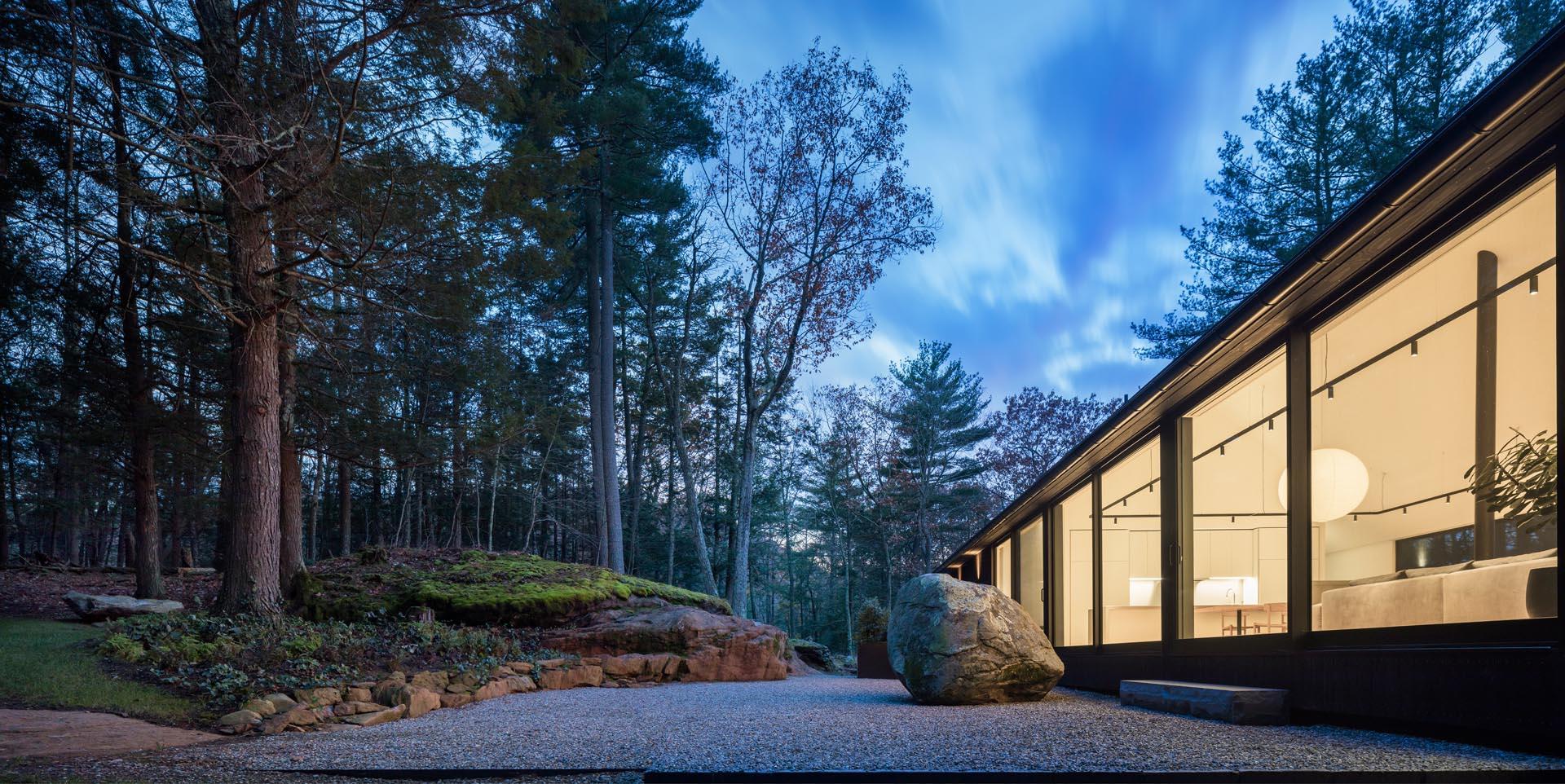 A modern house with a minimalist rock garden.