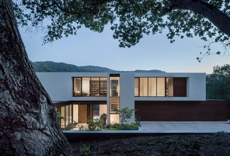 Windows Slice Through The Solid Exterior Of This Modern Home In California