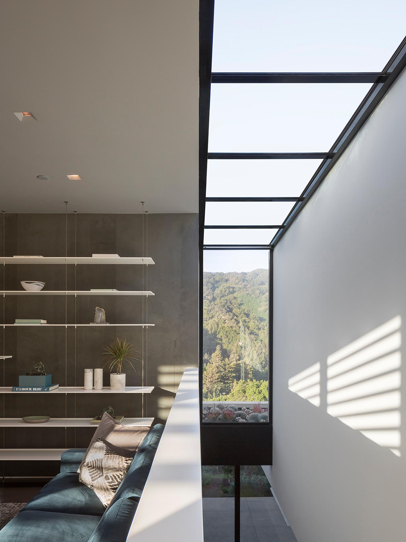 This modern house has a window that slices through a double height interior space.