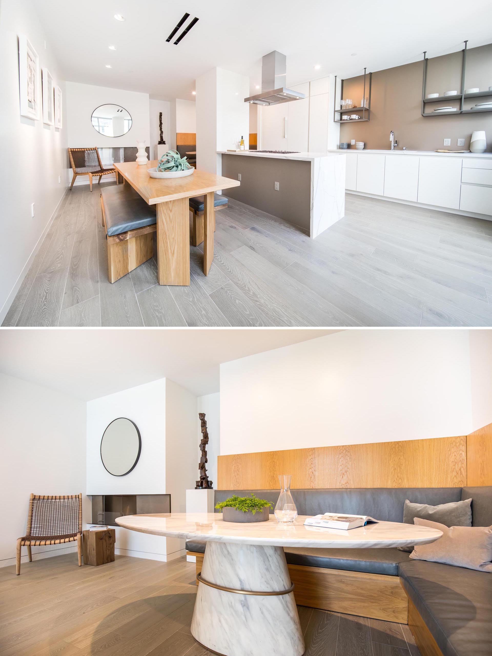 A modern kitchen and dining area with banquette seating.