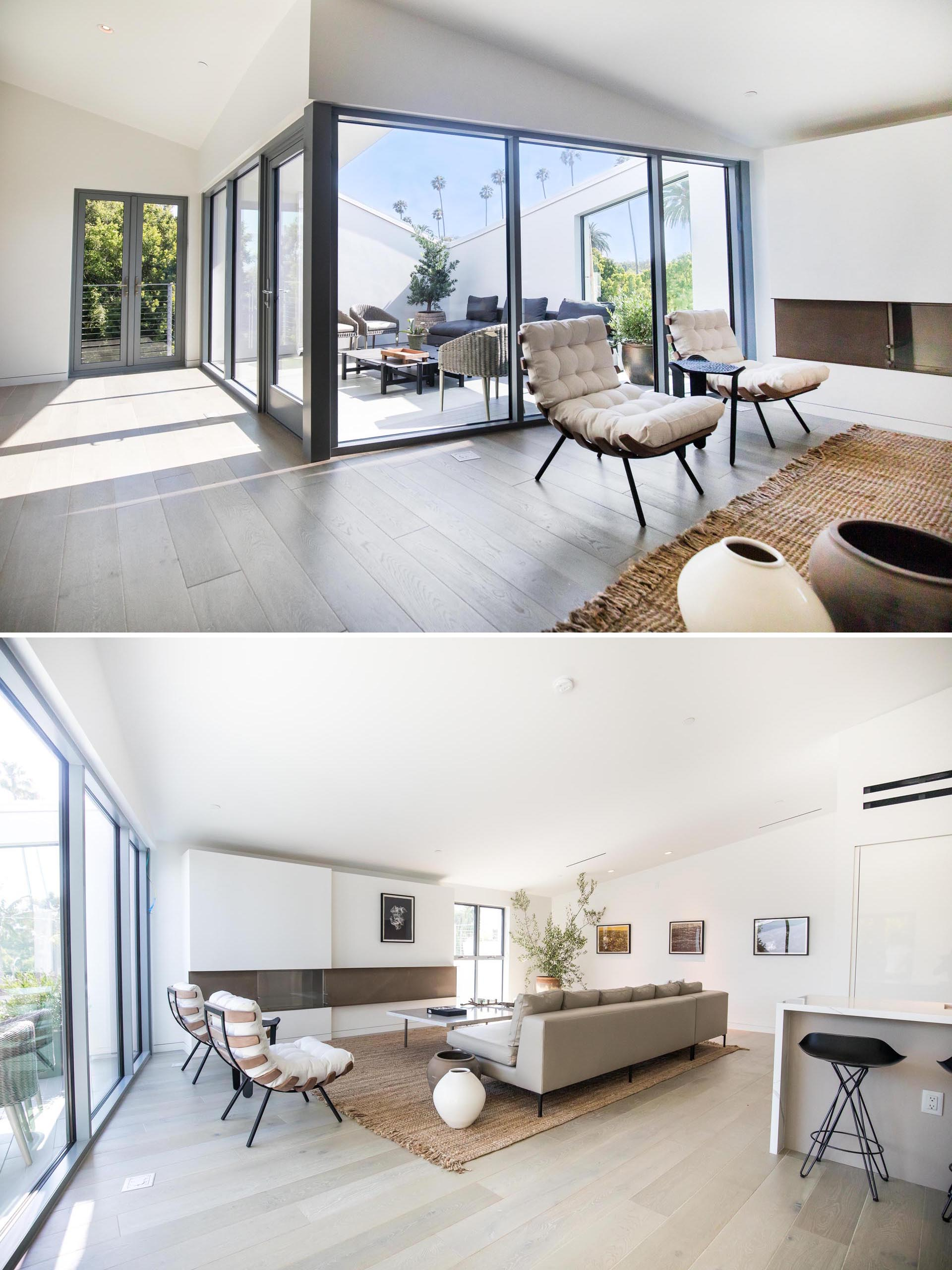 A modern living room with high ceilings, and sliding glass doors that open to a terrace.