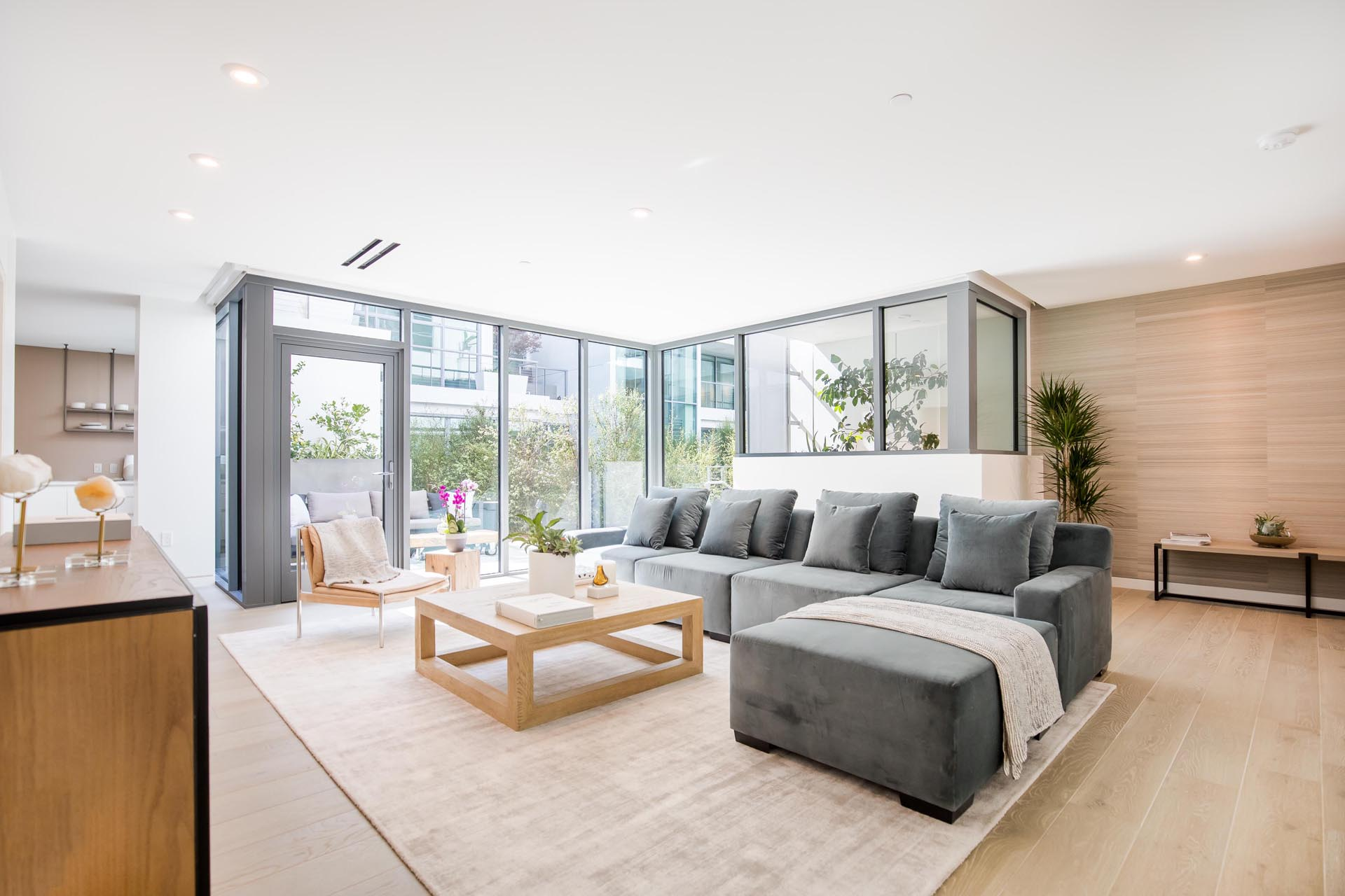 A modern living room with gray sofa.