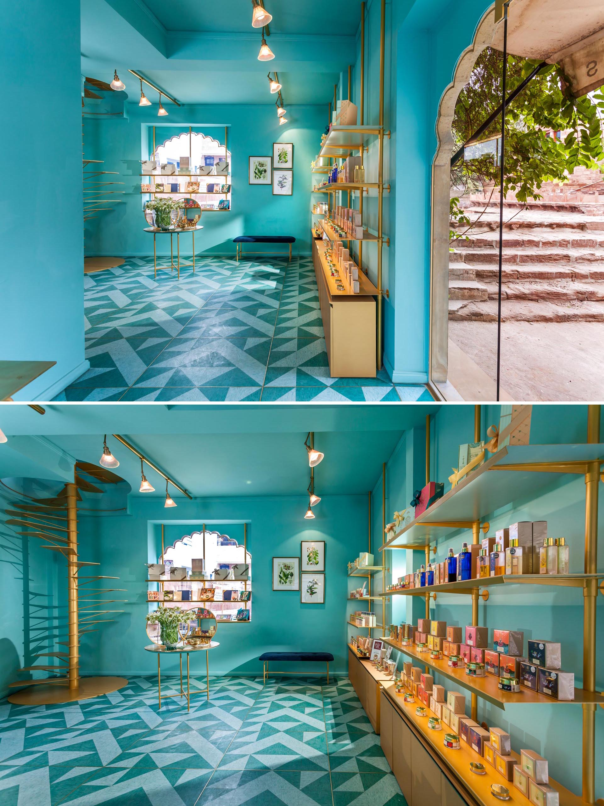 A modern retail store with teal blue walls, gold accents, and patterned lino flooring.