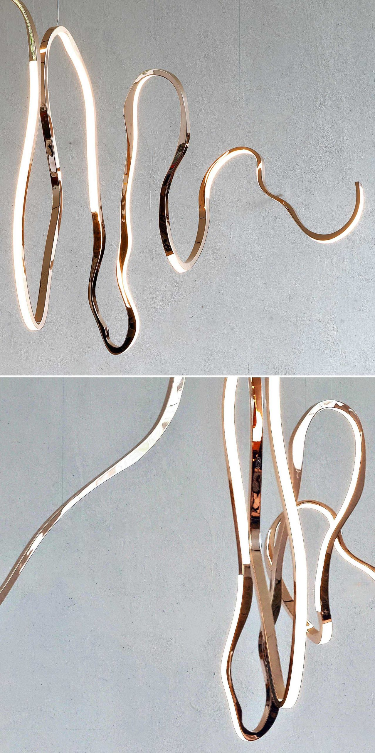 A modern sculptural light made from mirrored bronze, glass, and LEDs.