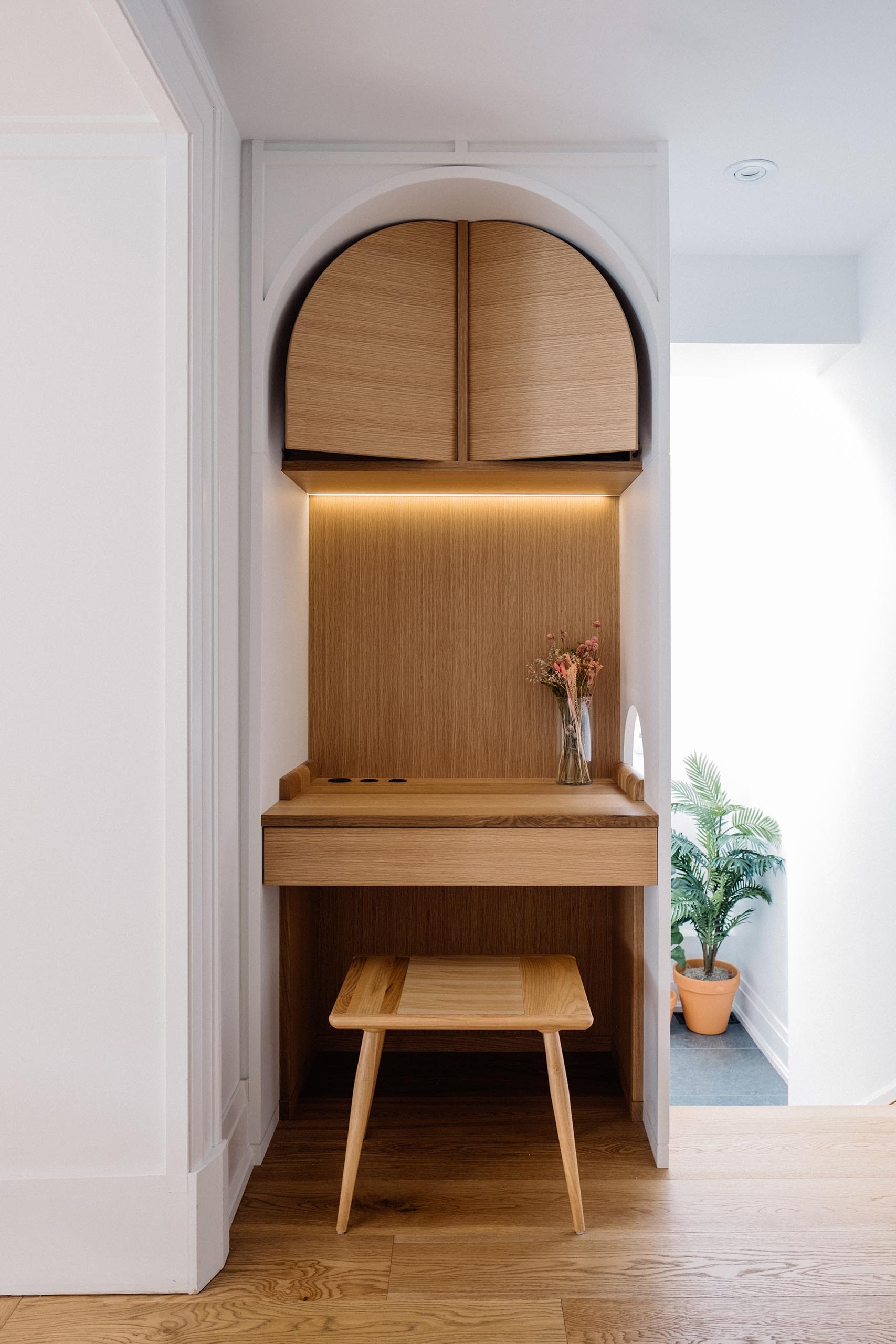 A small home office makes use of an awkward nook, and now includes storage and a desk.