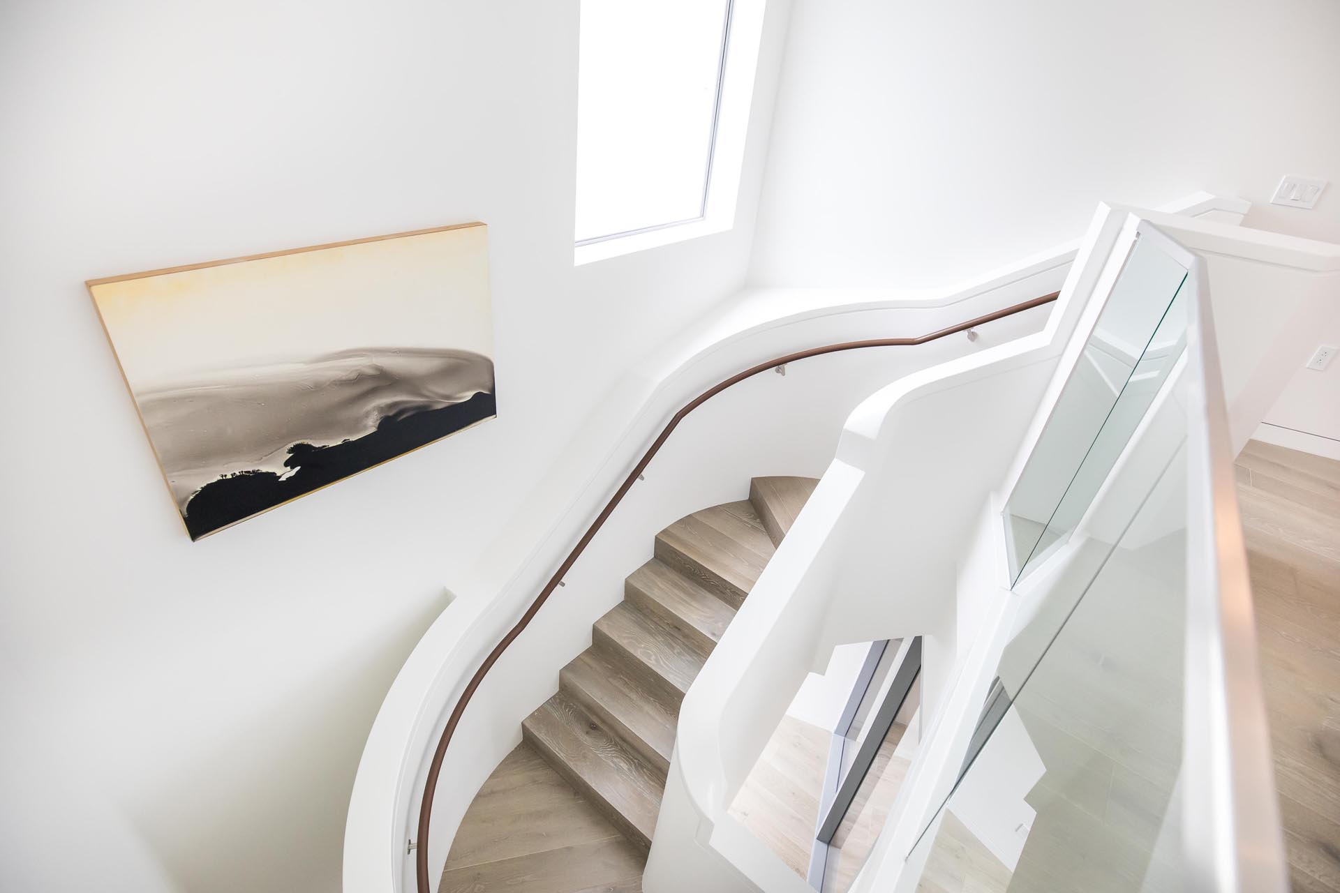 A white and wood sculptural staircase.