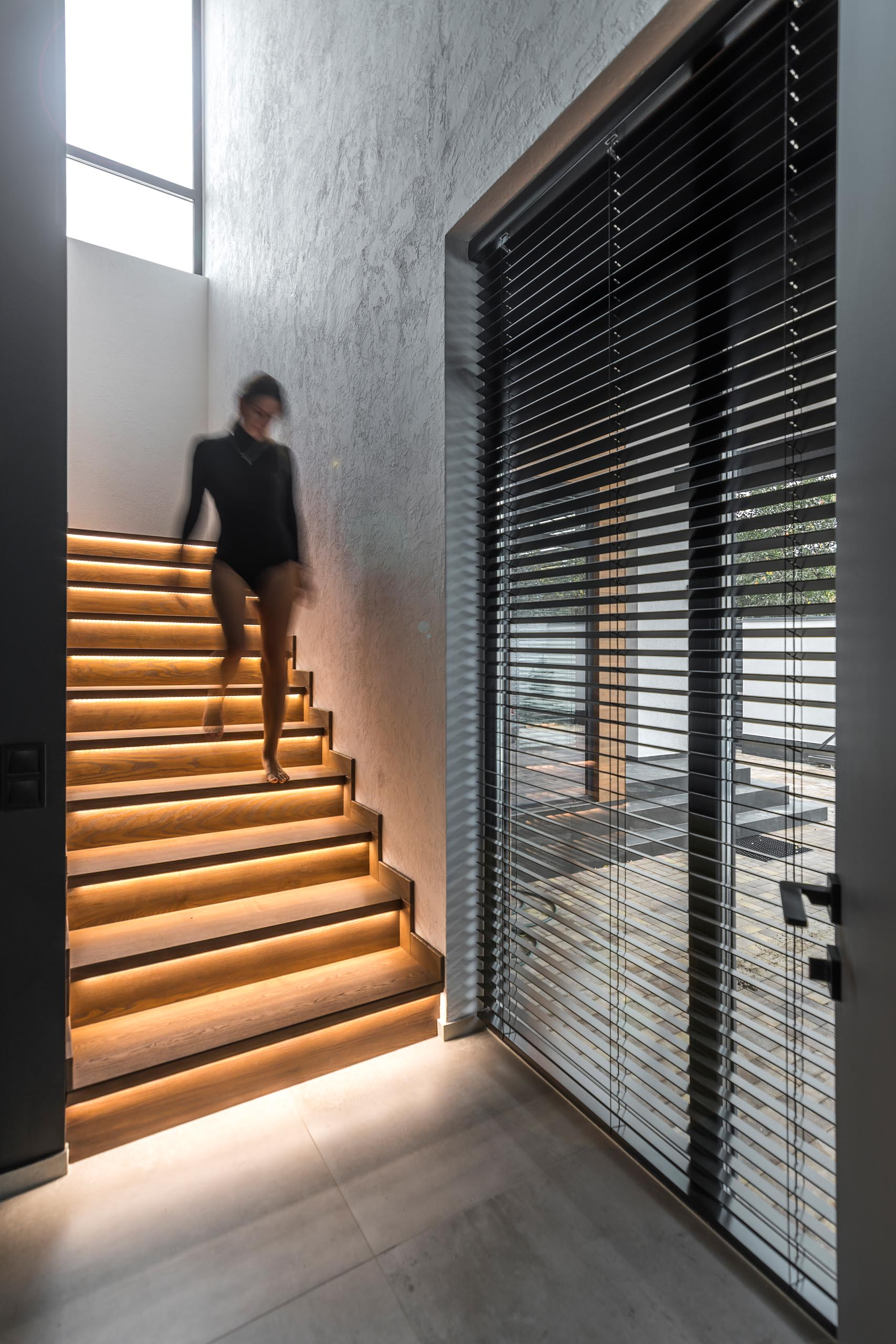 Modern wood stairs that have hidden lighting.