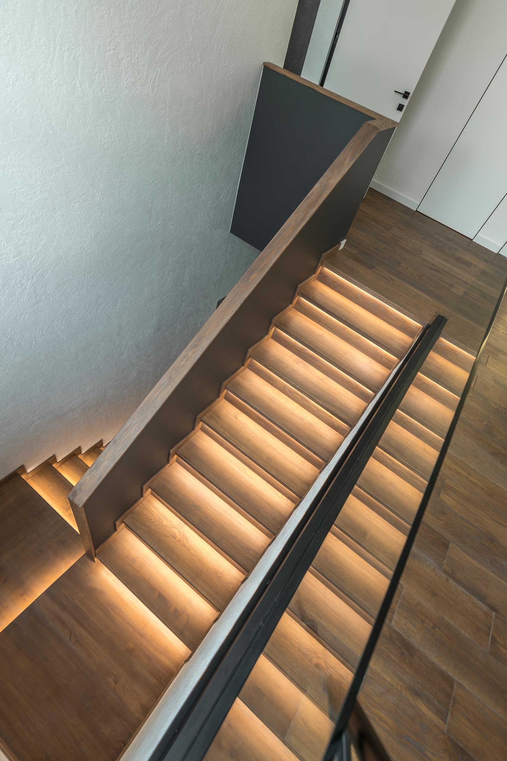 Wood stairs with hidden lighting.