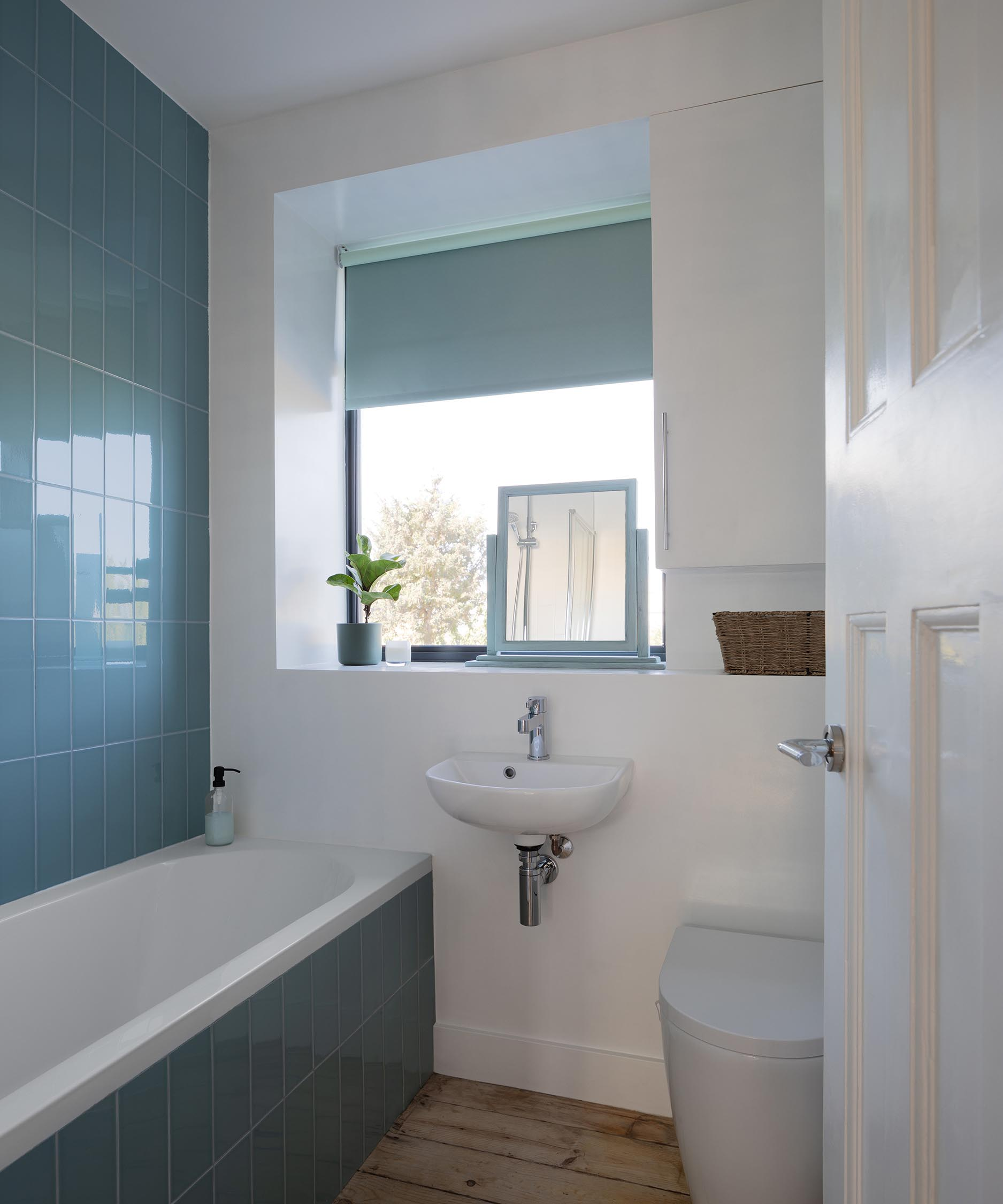 A bathroom with blue tiles.