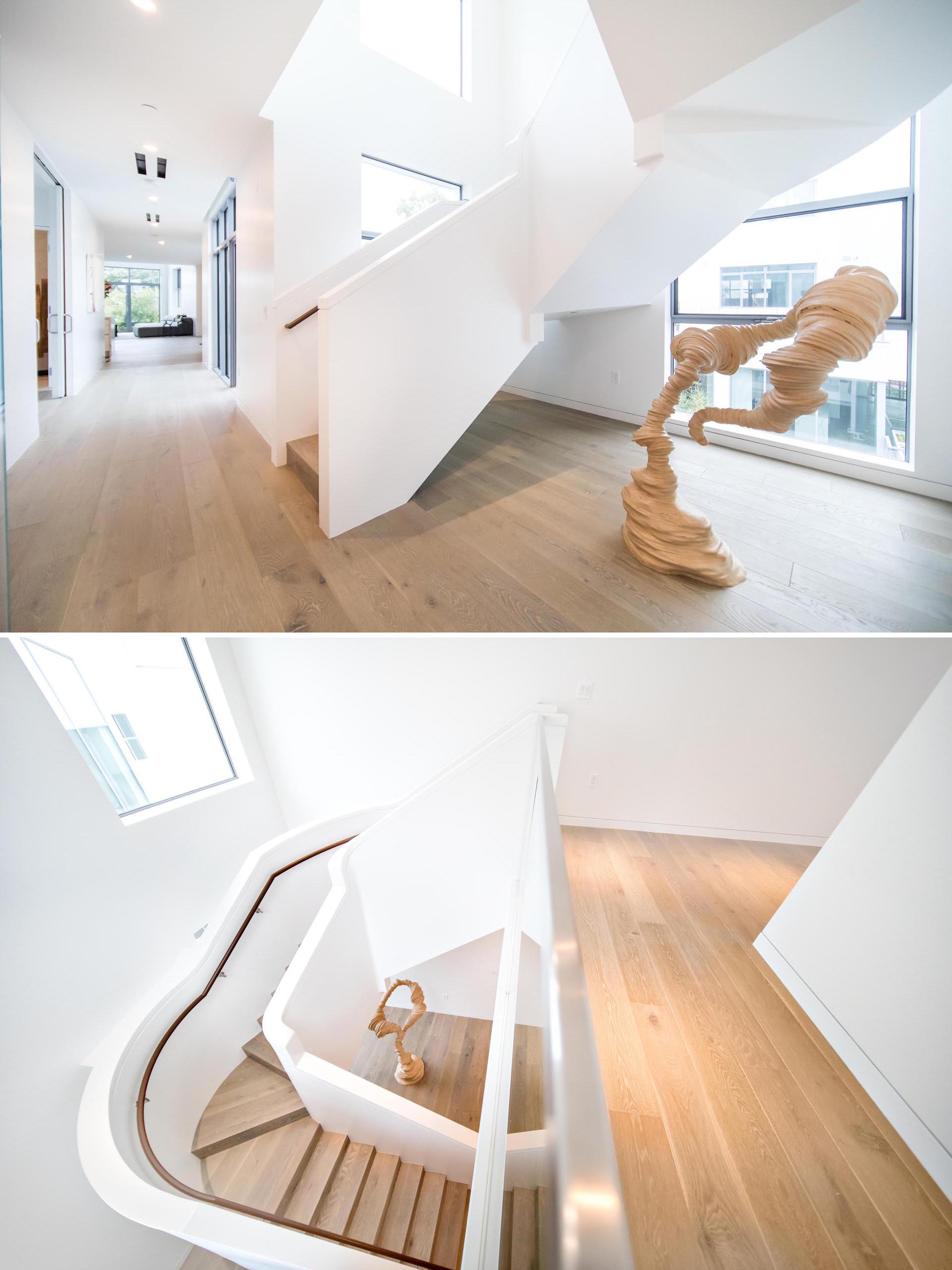 A modern white and wood sculptural staircase.