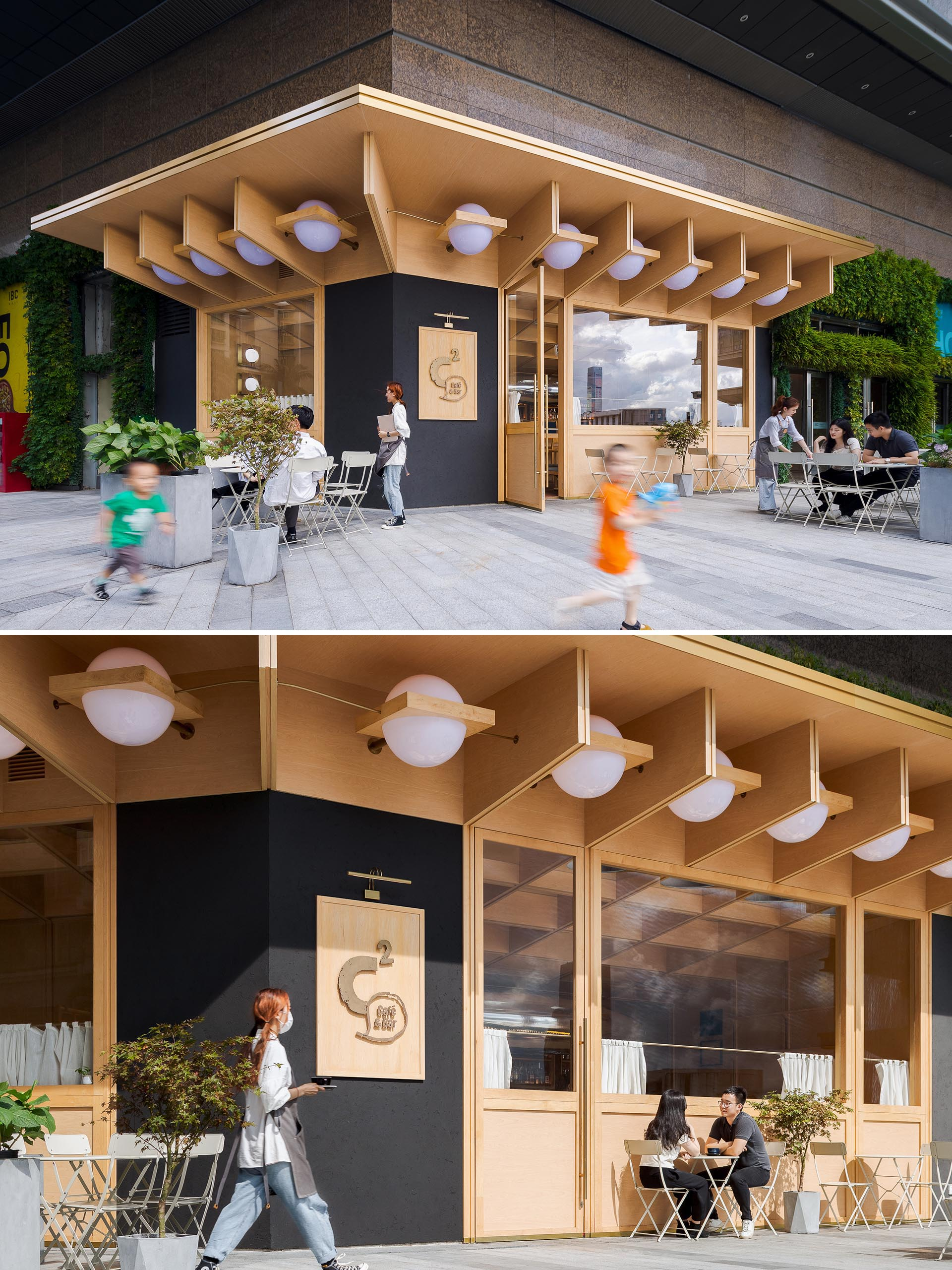 A modern cafe and bar with a wood exterior and outdoor seating.
