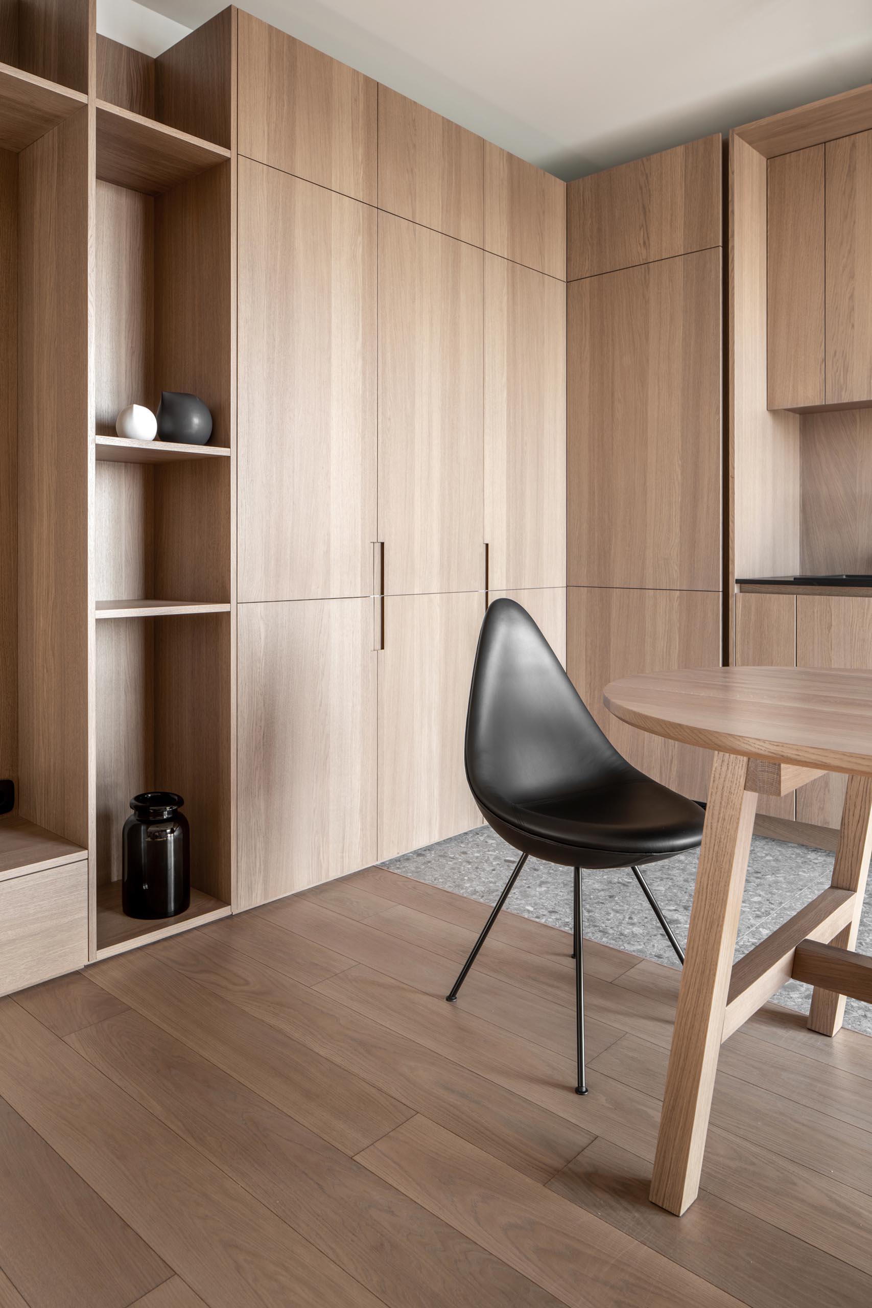 Modern wood hardware free kitchen cabinets.