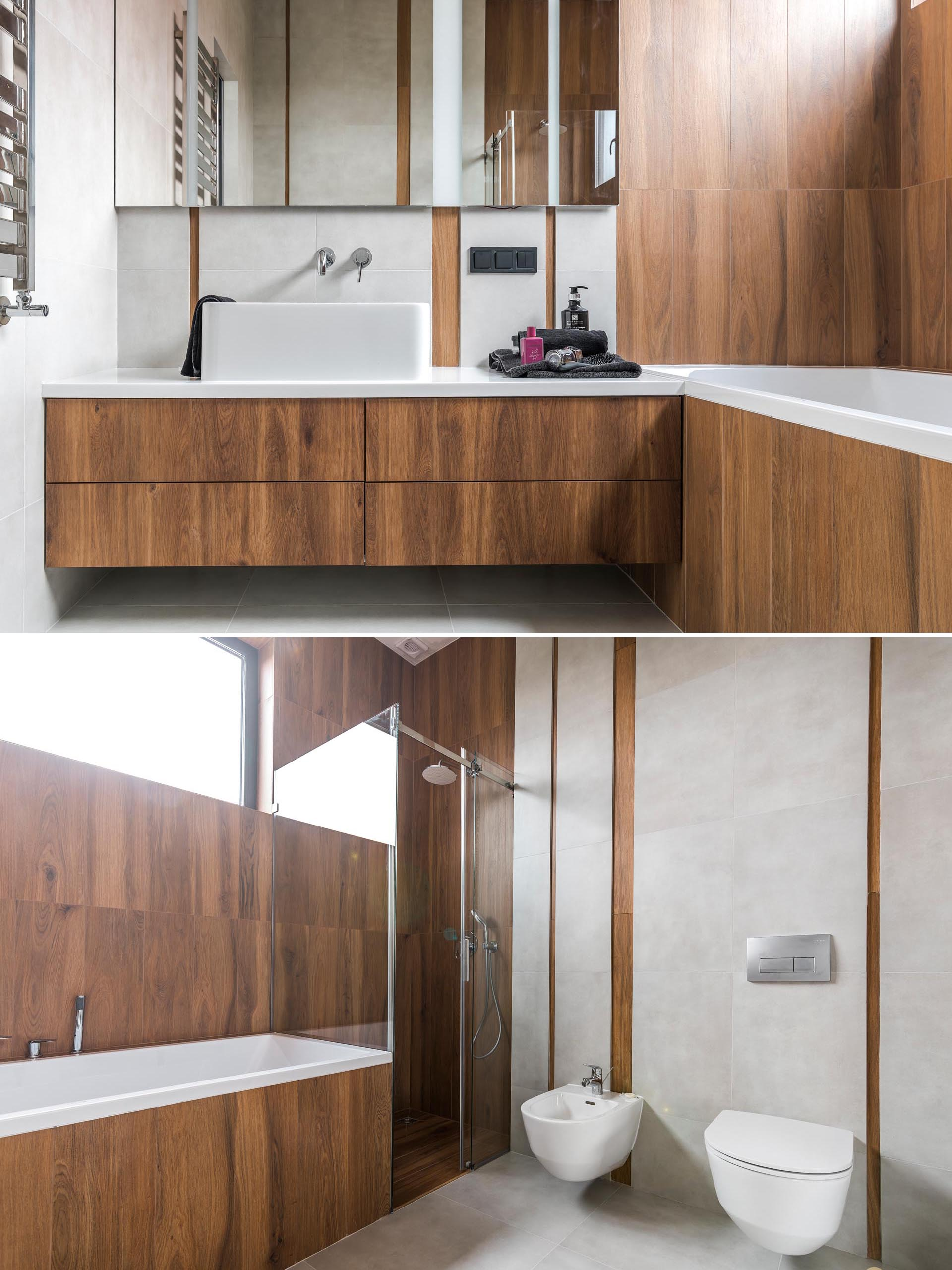 A modern wood-like tile covers a bathroom that also includes a white counter and sink.