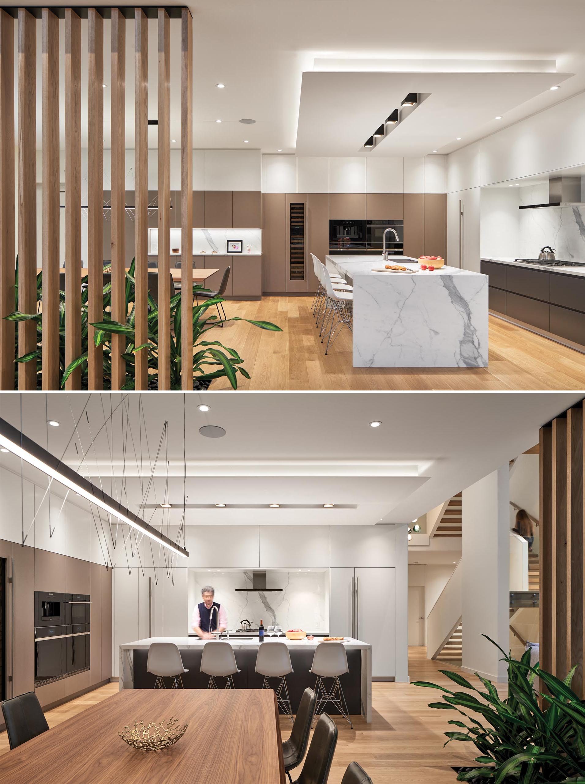 In this modern dining room and kitchen, a wall of tan cabinetry connects the two spaces. In the kitchen, a large island creates additional counter space and room for seating, while the black and white cabinets have a more minimalist look.