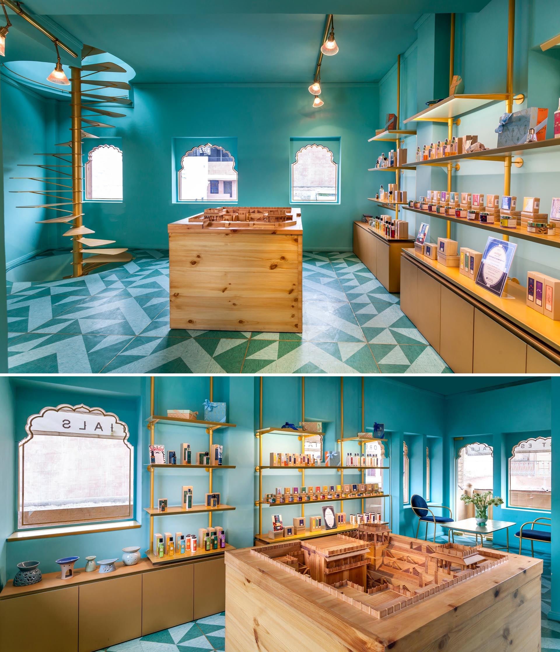 A modern retail store with teal blue/green walls, gold shelving, spiral stairs, and patterned floor.