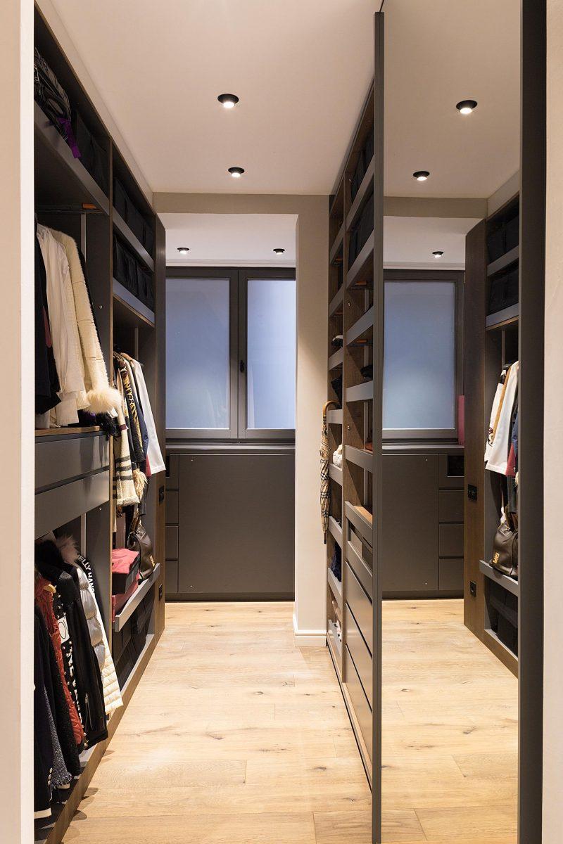 A custom-designed walk-in closet with plenty of storage.